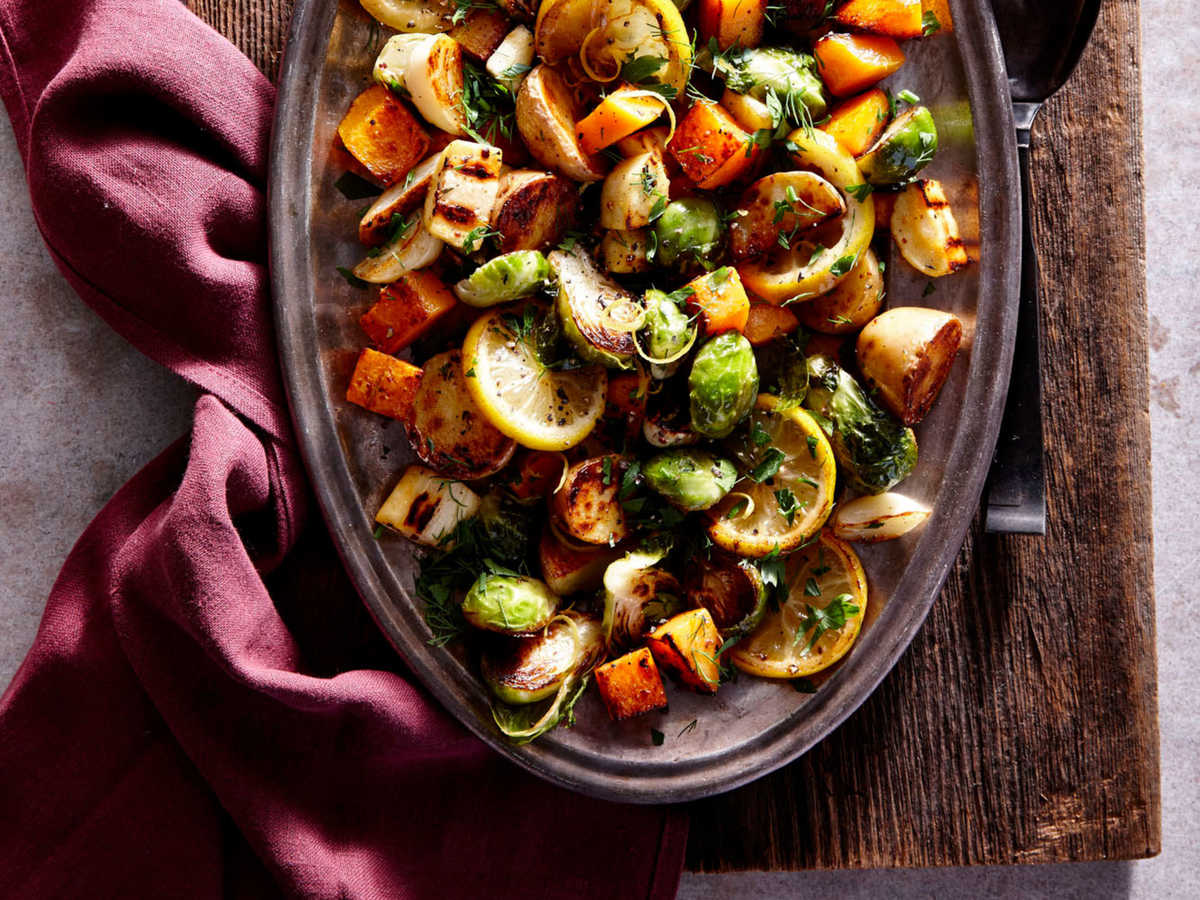 Combine 3 tablespoons olive oil, 1 teaspoon kosher salt, and 1/2 teaspoon black pepper in a bowl, stirring with a whisk. Combine butternut squash, parsnips, Brussels sprouts, and potatoes from master recipe in a large bowl, then follow remaining steps.