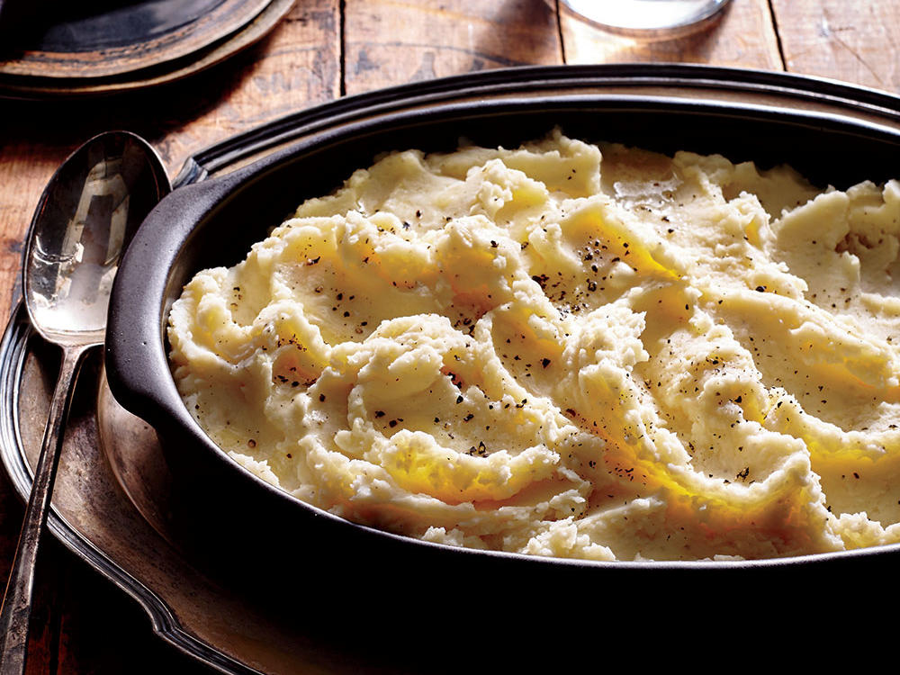 Keep mashed potatoes warm by placing in a heatproof bowl, covering with plastic wrap, and setting over a saucepan of gently simmering water. This will keep them moist and warm without scorching. A ricer finely breaks up the cooked potatoes without activating the potato starches, which could make the consistency gluey. It also allows the butter and liquid, such as milk or buttermilk, to quickly incorporate so the mash is smooth and free of lumps. If you don't have a ricer, use a potato masher, being careful not to overwork the potatoes. Our Butternut-Swirled Mashed Potatoes and Roasted Garlic and Parmesan Mashed Potatoes variations require a little extra time but are well worth the effort.