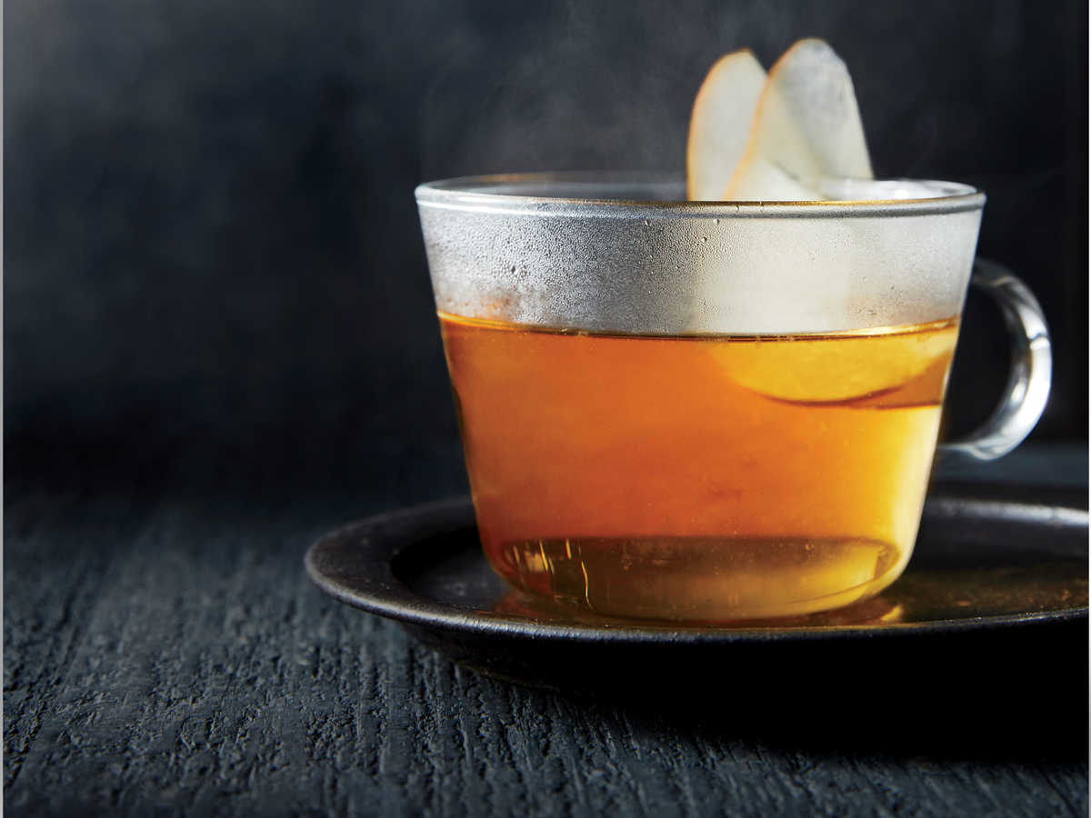 This hot toddy comes together in a flash thanks to the microwave. A touch of salt, though it may seem counterintuitive, actually heightens the sweetness of the drink, though the beverage is far from cloying. Pear vodka, such as Absolut, can be found at most liquor stores. We love the floral fruit flavor of pear, which is perfect for late fall. Cognac adds a little oak-cask richness and complexity to the mix. We add the liquor to the hot sugar mixture, which yields a very warm drink that can be sipped right away. Moreover, it avoids safety concerns with heating flammable alcohol. A little fresh lemon juice adds a bright top note and balances the sweet pear flavor with light tang.