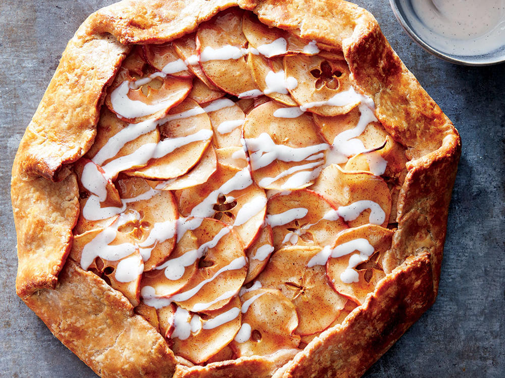 "Rustic is gorgeous—that's never been more true than with this fall apple tart. We save on sat fat and make the crust more tender by swapping in low-fat yogurt for some of the butter (use standard yogurt, not Greek-style). Make dough ahead and refrigerate or freeze (just remember to thaw completely before rolling). Cutting the apple crosswise for a ""star"" shape in the center of each slice adds a special touch, but any slice will work. You can sub the scraped seeds from one vanilla bean pod or 1 teaspoon vanilla extract for the vanilla bean paste."