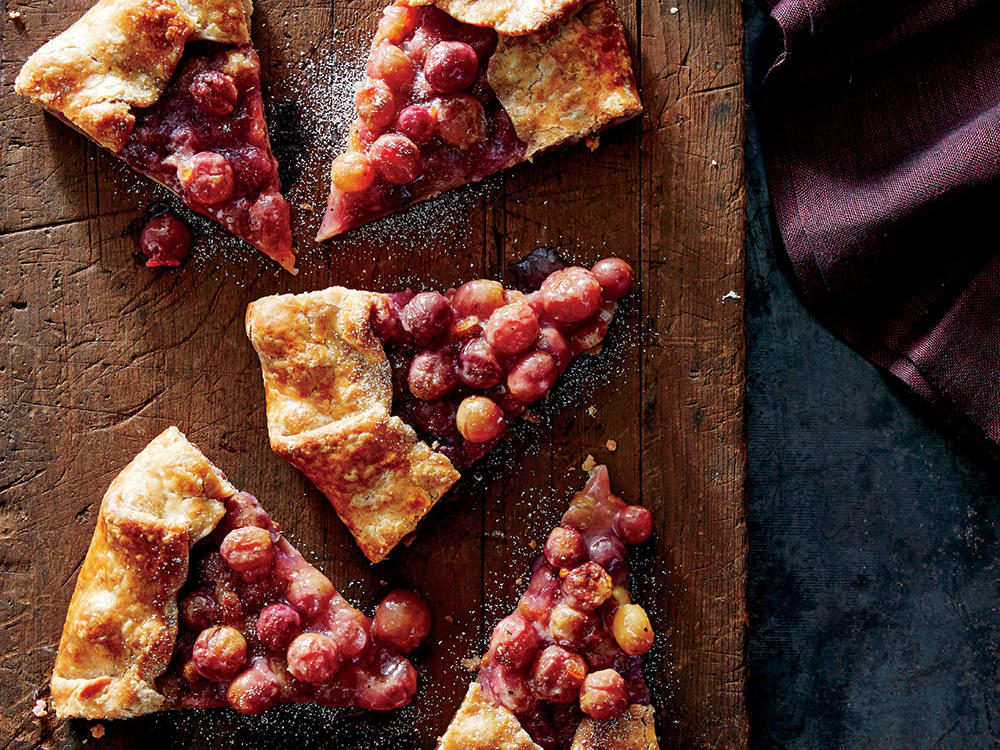 Take a break from traditional holiday pies and try this grape tart instead. The grapes become tender and intensely juicy in the oven. Floral, slightly bitter marmalade helps to bind the filling and balance the fruit. Let the galette sit at room temperature while you complete your holiday prep so the juices can thicken. Warm in a 300°F oven for 10 minutes before serving.