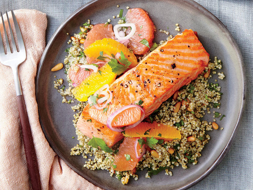 Consider this light dinner an antidote to a season of rich stews, braises, and roasts. Serve with Cilantro Quinoa with Pine Nuts for date night, or double for 4 people. The tart, bright citrus topper cuts through the natural fattiness of the salmon; it would overwhelm lighter fish like cod or flounder. After freeing the citrus sections, squeeze the membranes over a bowl and make a quick vinaigrette for enjoying during the week. Change up the salsa with chopped tart-crisp apples and a seeded minced jalapeño, or try diced ripe pear and pomegranate arils.