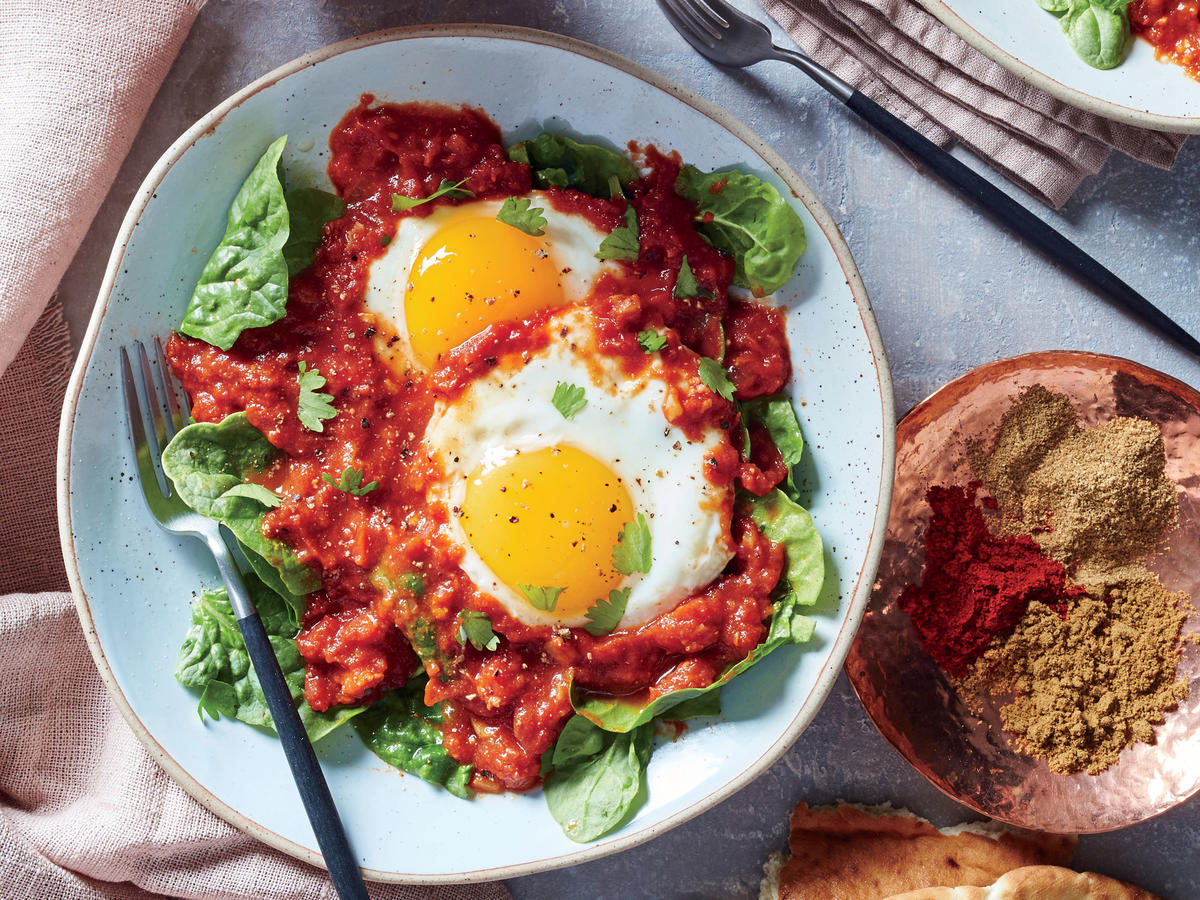 We're not entirely certain about the history of this classic recipe's name, but perhaps it has something to do with the spicy kick of the sauce. Our version is a shakshuka-like dish in which fiery harissa paste and heady spices slowly infused a rich tomato sauce where eggs gently poach. Look for jars of harissa with the Middle Eastern foods in your supermarket; you can substitute a half to full teaspoon of crushed red pepper in a pinch. The cook time for the eggs depends on the specific heat of your slow cooker. We offer a range of 15 to 20 minutes, so start checking at 15 minutes (or a couple minutes earlier) to ensure the eggs get done to your liking.
