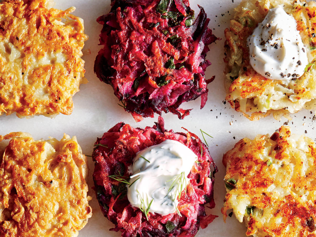 Borscht-inspired beet and beet greens come together in these sweet and hearty Hanukkah latkes. Not only do these use up the entire beet, but they're a fun, colorful variation on the classic potato latke. Dunk them in sour cream or unsweetened applesauce to brighten the flavor and bring you Hanukkah latke bar to life.