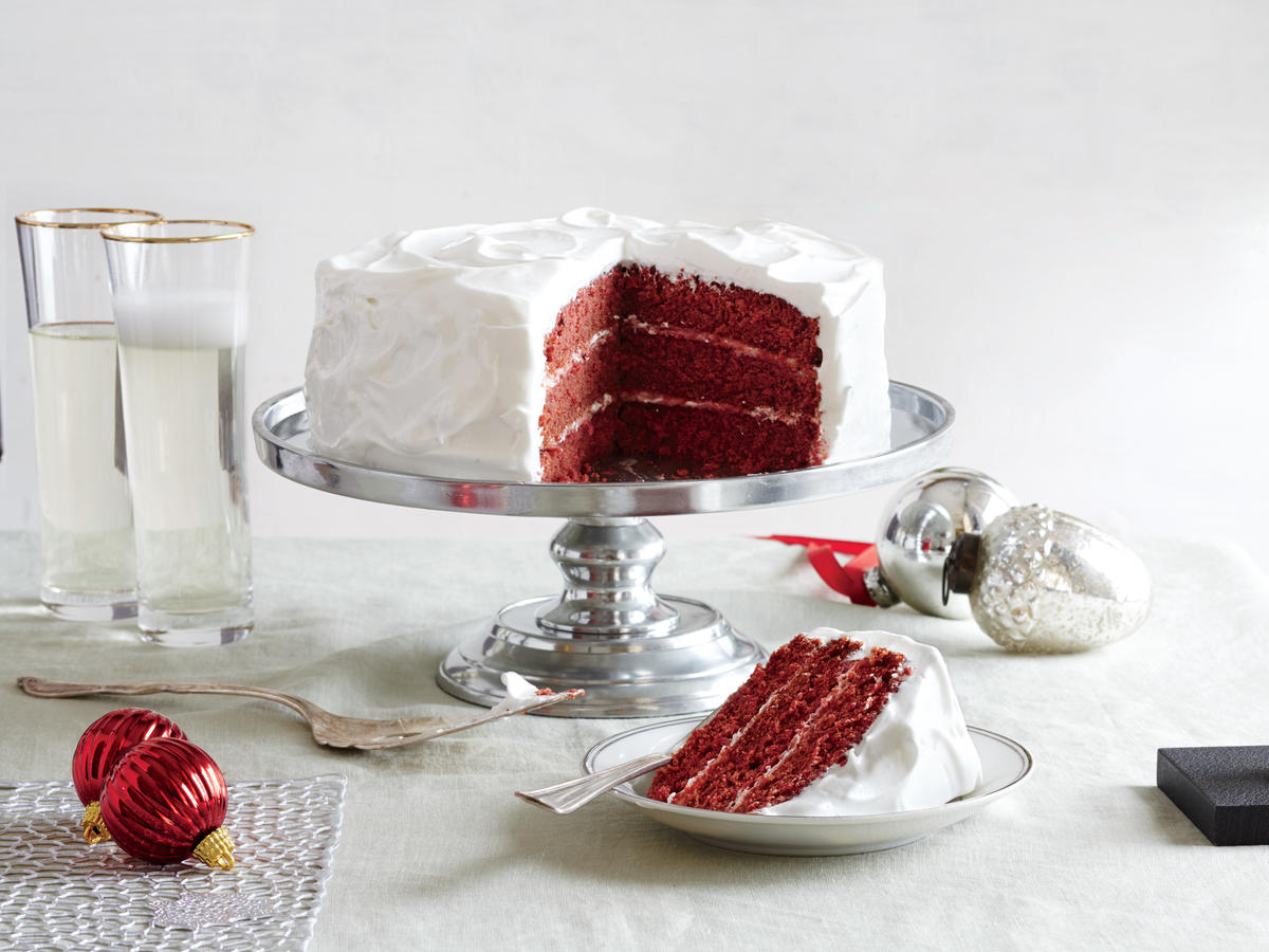 "Just the name ""red velvet cake"" suggests something elegant and rich—dramatic, supermoist layers of tinted chocolate cake coated in a dense, creamy white frosting. 'Tis the season for such decadent pleasures, right? Although it may be the time of year to splurge, it's hard to justify an 880-calorie, 57g-of-fat piece of cake. Ho-ho-holy cow! We had to find a better way to bake this favorite holiday cake and feel better about eating it, too.