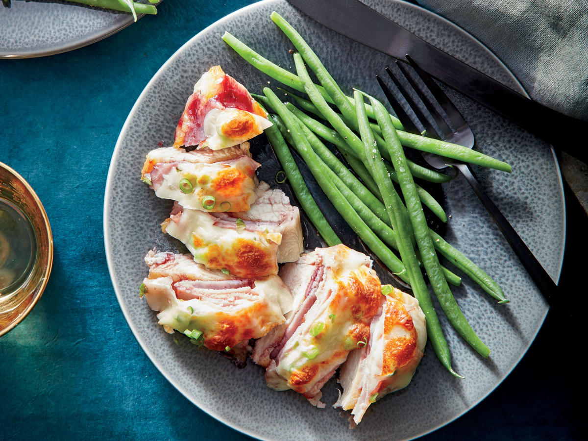 This recipe is a play on chicken cordon bleu that's far easier to prepare. Instead of stuffing chicken breasts with jam and cheese, we broil cutlets until done and simply top them with ham, cheese, and a touch of jam. We also tested the dish with cheddar, which you could use in a pinch, but the nutty, tangy flavor of Havarti makes it feel more special.