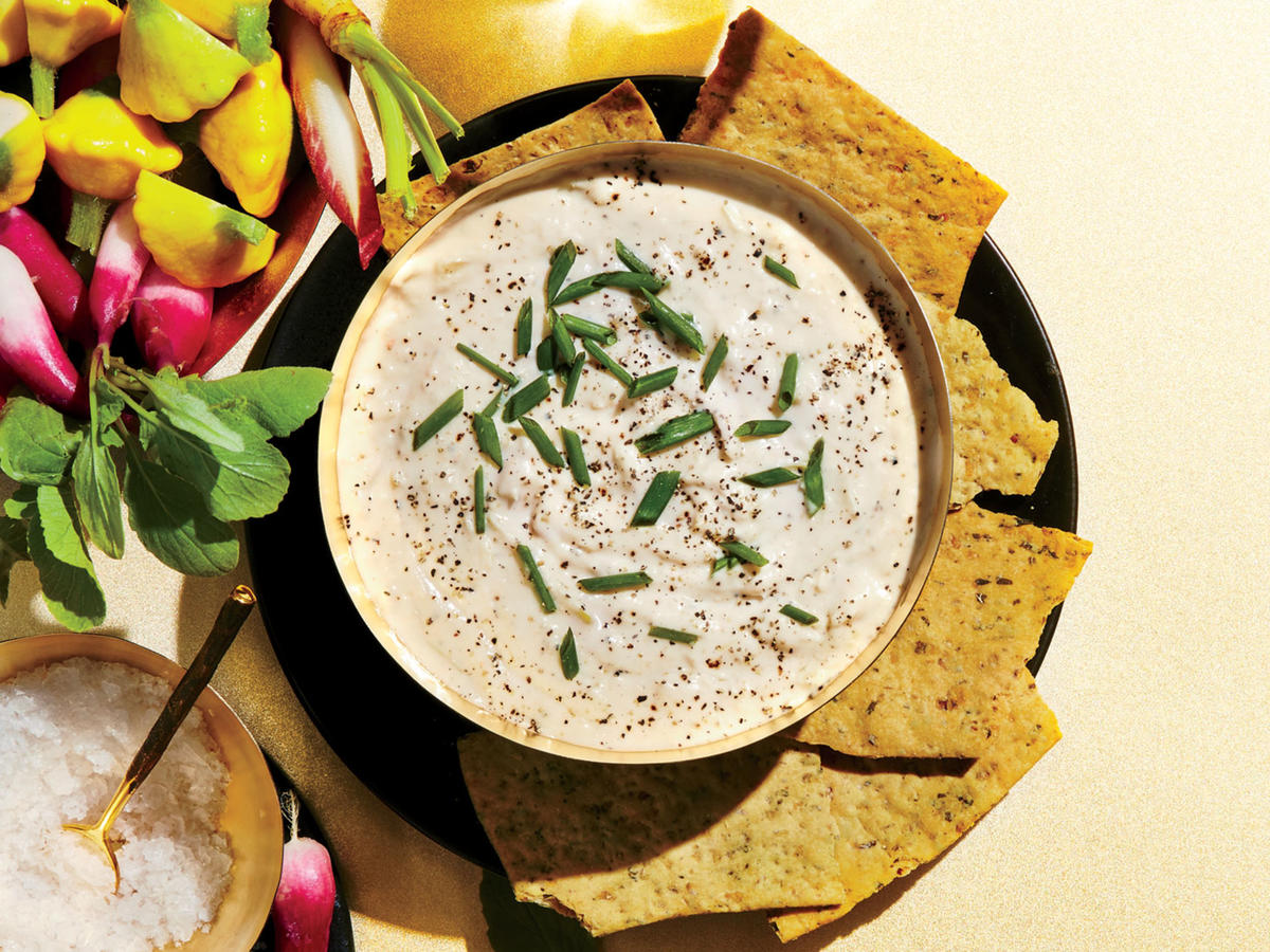 This warm, tangy twist on fundido is perfect with sparkling wine; the bubbles help cut through the richness. We pair with veggie chips, but you can also serve with crudités for a fresher take. The dip is very easy to put together. One note on mixing: Blend the beans until they are completely smooth and puréed for the silkiest, creamiest results. You can't overblend it, but if you stop too soon, the dip might have a few lumps. The great thing about this dip is that it can be made ahead and rewarmed when you're ready to serve it. To reheat, stir gently over low heat until hot. For an herby version, add a generous 1⁄4 cup of a mix of chopped herbs, such as parsley, chives, and a little basil.