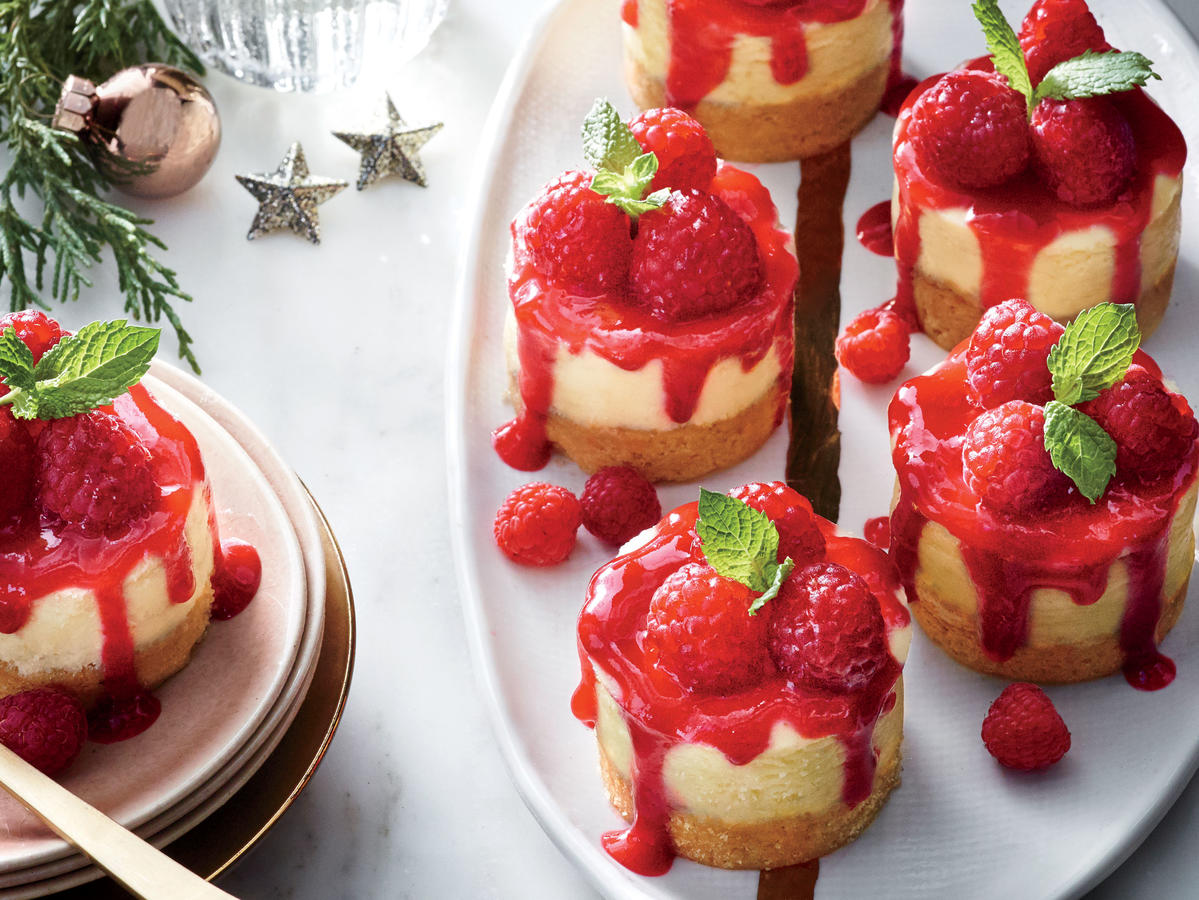 We had the greatest success using a pan with 2 1/2-ounce cups, such as Chicago Metallic's 12-Well Mini Cheesecake Pan ($25). This pan has removable bottoms (similar to a tart pan) so that you simply push each cheesecake up to remove it. You can also bake them in a standard muffin tin; line it with foil liners for easier removal.