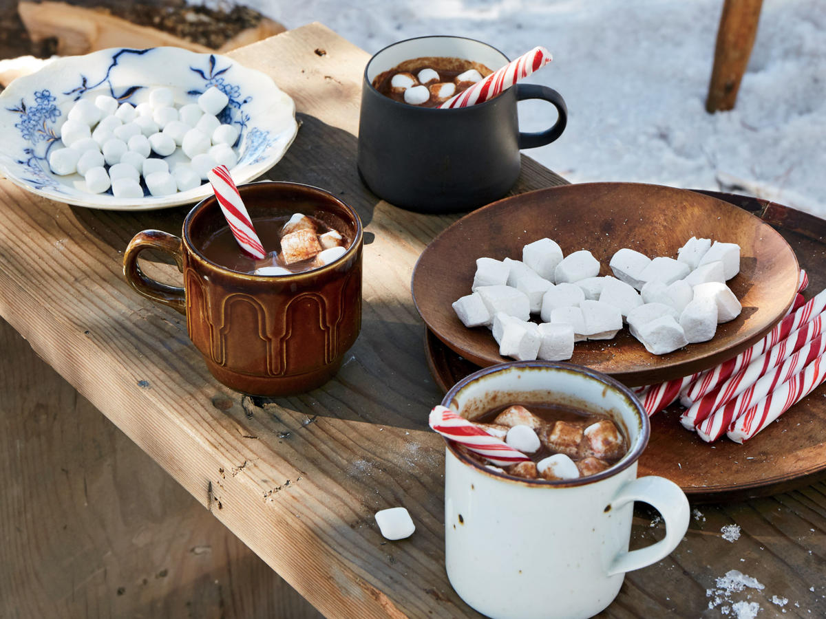"This warming treat is the perfect accompaniment for a walk through the snow: A hint of peppermint schnapps will give everyone a little pep in their step. Think of it as more of a dessert than a beverage, as this hot chocolate is a bit of a splurge. Canned coconut milk gives it full-bodied richness and makes it an indulgence. Blogger and cookbook author Molly Yeh explains that ""coconut goes well with chocolate and mint, so it really brings this hot chocolate together nicely."""