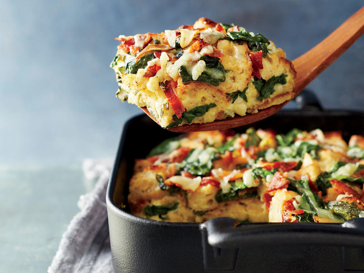 This dish has fewer than 20g of total carbs—about half of what you'll find in classic bread-based casseroles. Greek yogurt, eggs, and cheese pack a mighty protein punch, while a touch of bacon seasons to perfection. The strata is best if allowed to soak overnight. Not only does this build in make-ahead convenience, it also allows the bread to fully absorb the egg mixture—yielding a creamy texture inside, while the top bread pieces get delightfully crisp.