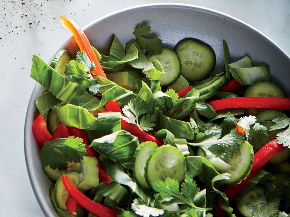 Thinly slice the bok choy stalks and leaves for a salad that's full of color and texture. You can also use larger bok choy, but save the wide, fibrous ends of the stalks for a dish where they'll be cooked.