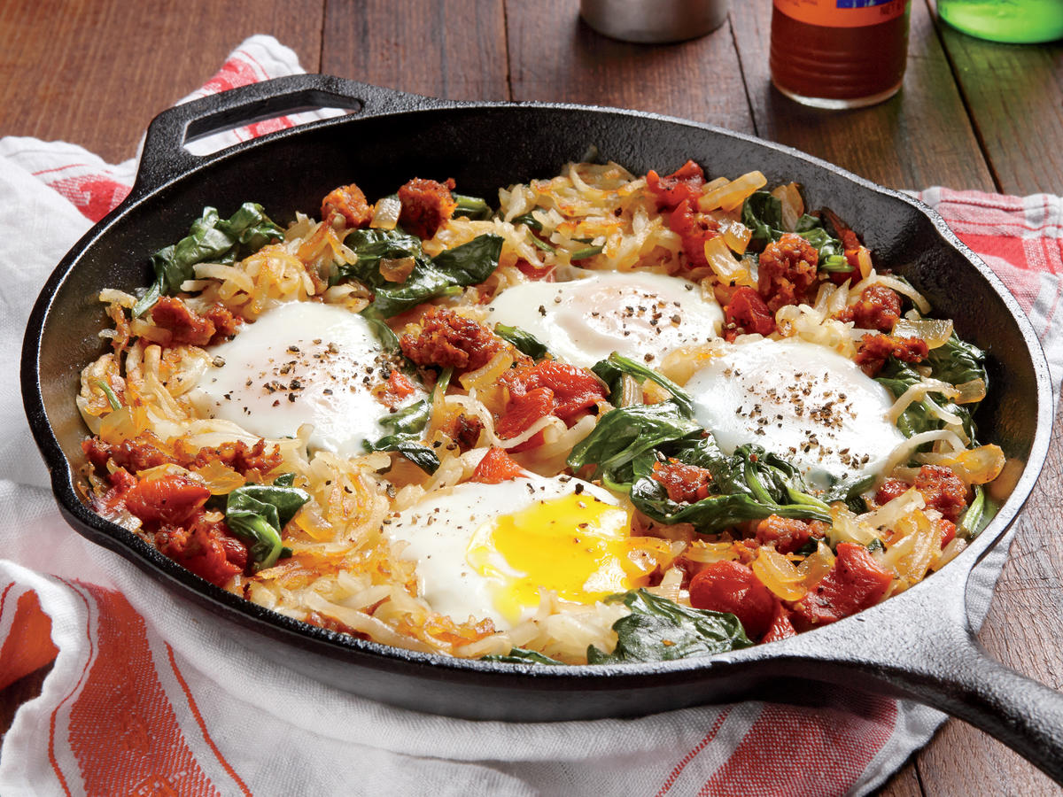 This breakfast-for-dinner skillet gets heat from spicy Mexican chorizo. Don't stir the potatoes too much as they cook so they crisp in the pan. If you like your eggs more firm, cook them longer, or stir them in for a scramble.