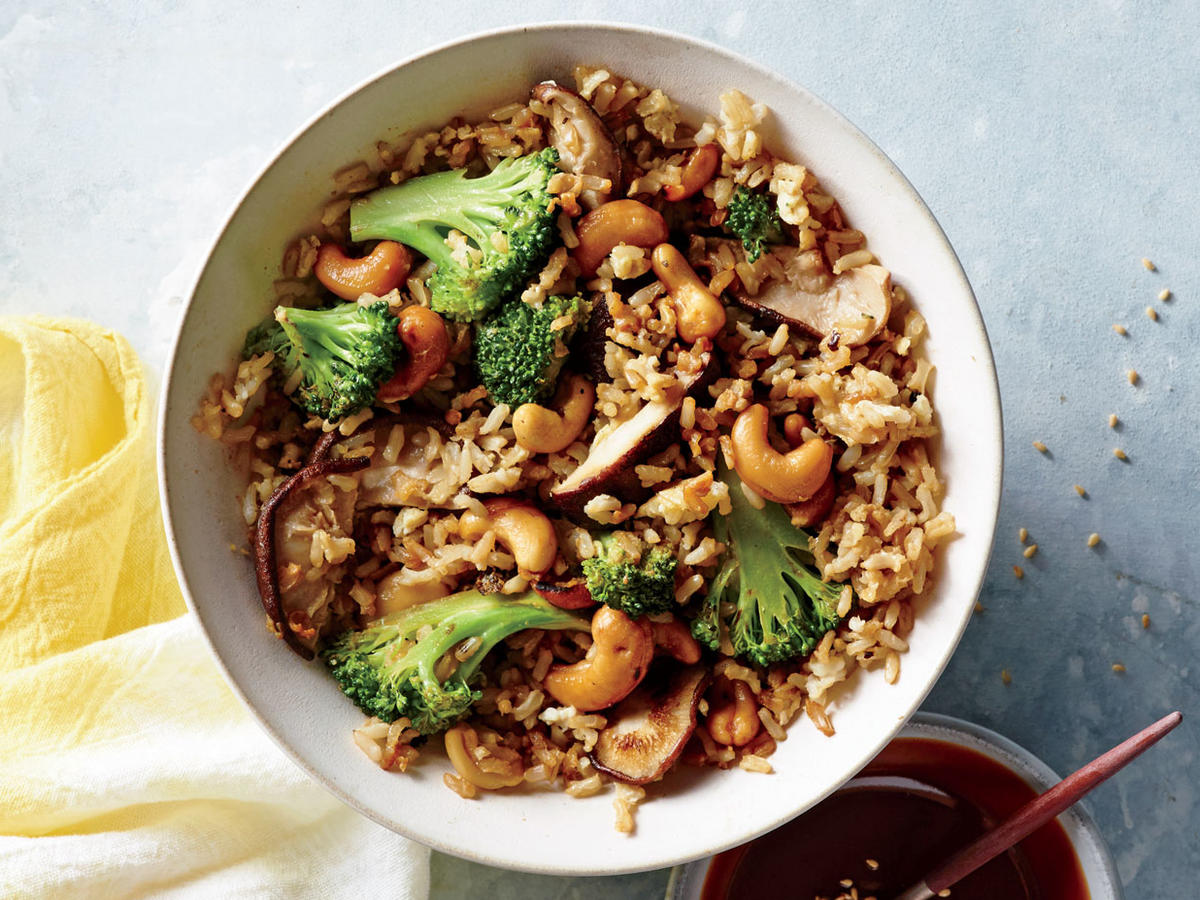 This hearty vegetarian dish is a fun twist on the usual takeout version of fried rice, incorporating lots of nutty flavor from toasted sesame oil, roasted cashews, peanut butter, and sesame seeds. The rice is drizzled with a savory, creamy peanut sauce that takes the whole thing right into indulgence territory. If you have a peanut allergy, opt for cashew, almond, or sunflower butter instead of peanut butter. Look for toasted sesame seeds on the spice aisle of your supermarket; it's a great ingredient to keep on hand for busy nights because it saves a step.