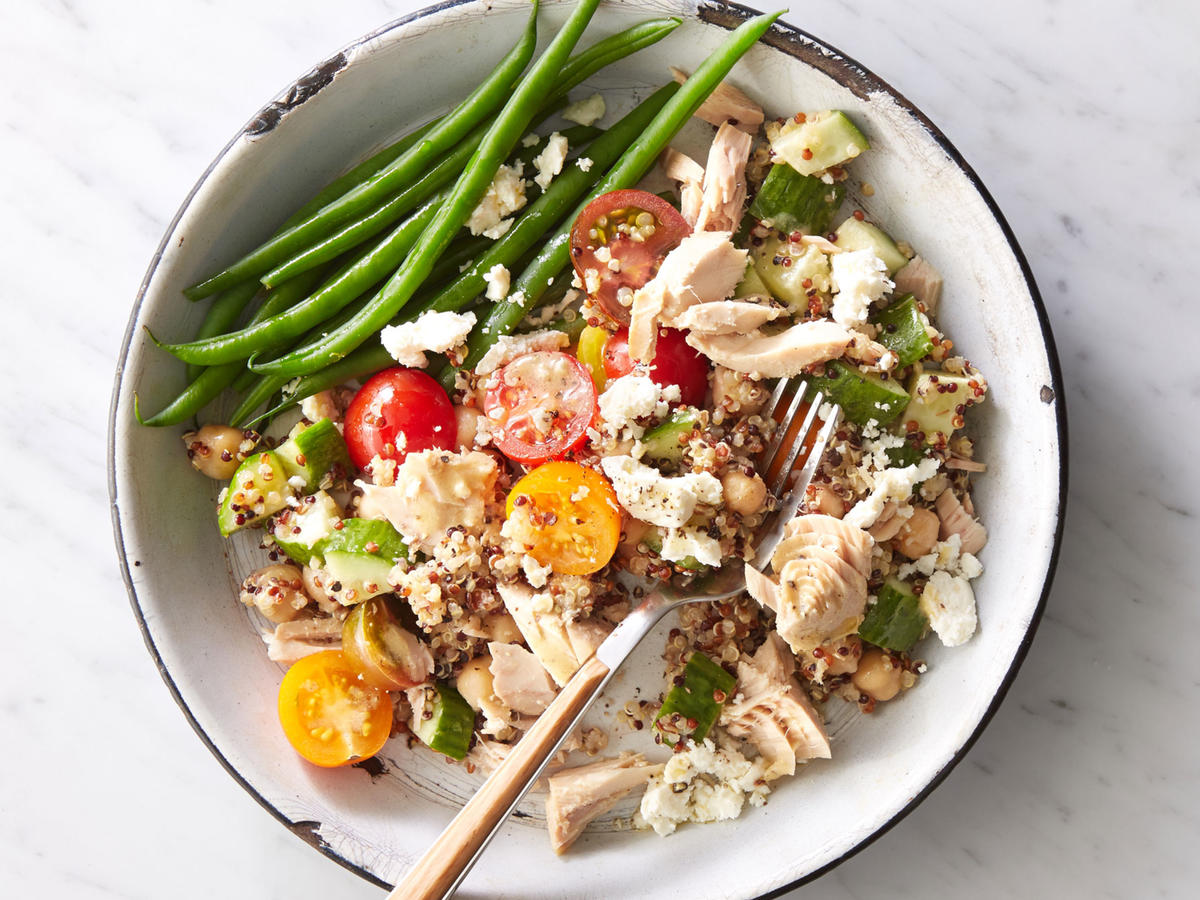 A whole-grain protein bowl is the perfect solution for when lunch needs to be quick—as well as tasty, filling, and healthy. Cook quinoa ahead of time (or buy precooked, available in pouches near the rice). To complete the lunch, serve with 1/2 cup steamed green beans as shown. Dairy-free option: Use 2 teaspoons toasted chopped walnuts instead of feta cheese.