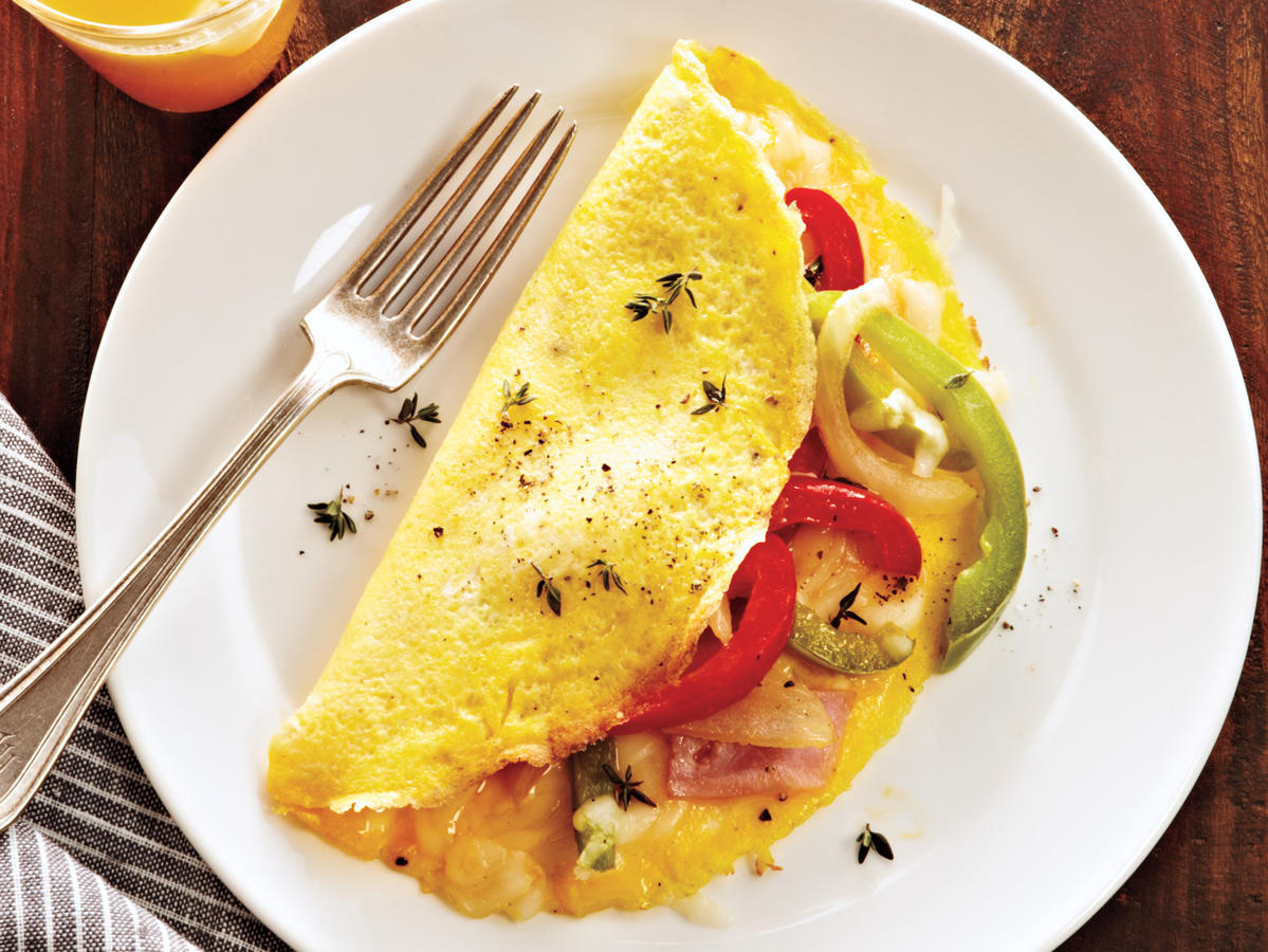 This omelet delivers the classic diner-style overstuffed package brimming with bell peppers, ham, and cheese—perfect for a light breakfast, brunch, lunch, or dinner.