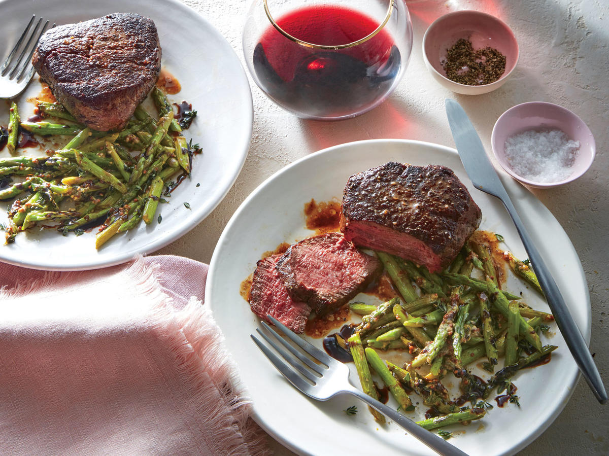 Beef tenderloin steaks are often considered a special-occasion cut, but when they go on sale (or you're ready for a splurge), this classic preparation is foolproof. Use a timer rather than turning, prodding, or overcooking the steaks, and set the timer again while they rest so you don't slice too soon. You could also use two (8-ounce) strip steaks, or 1 (1-pound) flank steak. Balsamic glaze has been reduced until syrupy. Look for it in the vinegar aisle to save time, or simmer 1 cup balsamic vinegar in a saucepan until reduced by half, about 20 minutes.