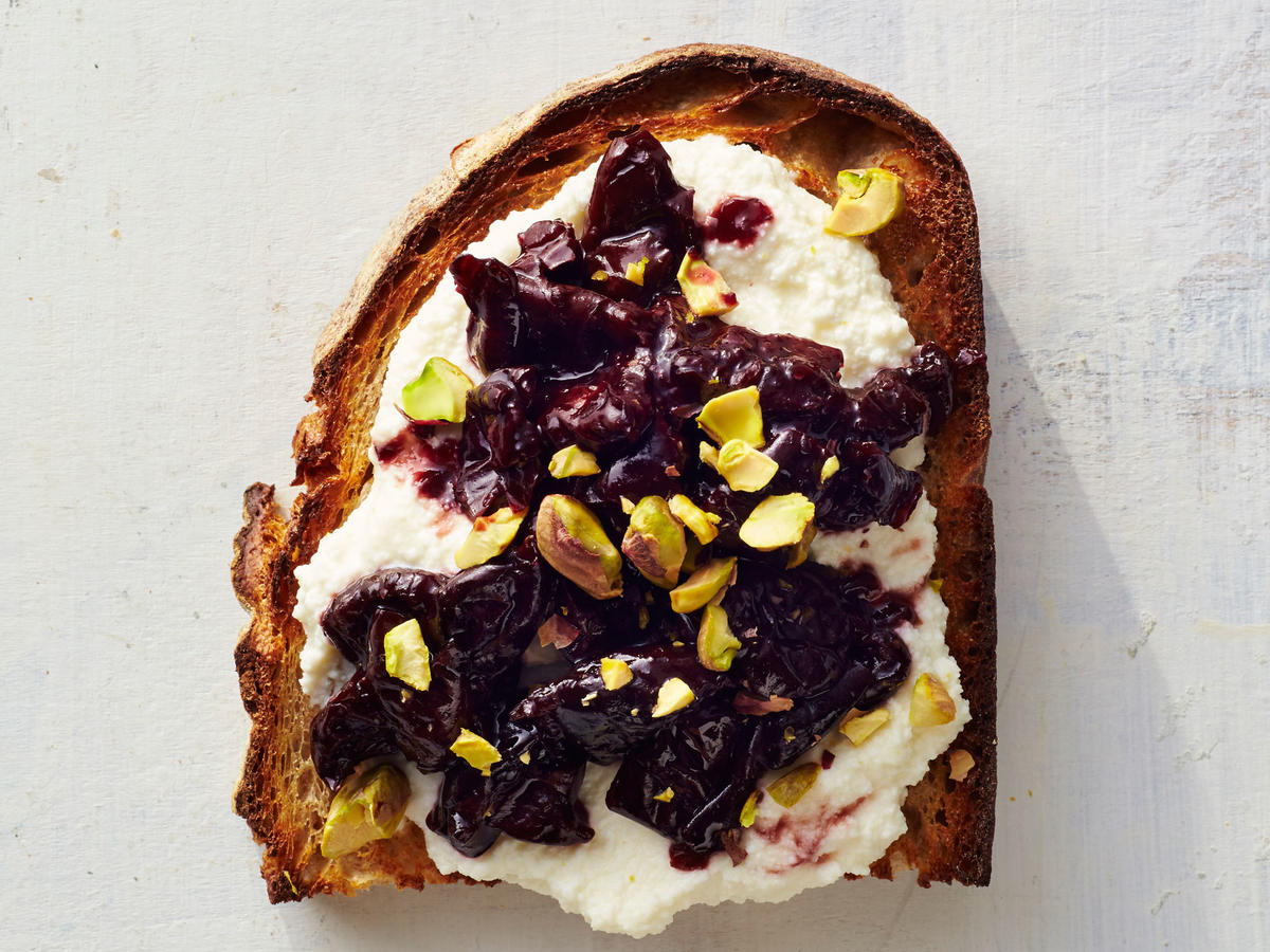 This toast is a world of textures thanks to the creamy ricotta, thick cherry spread, and crunchy pistachios.