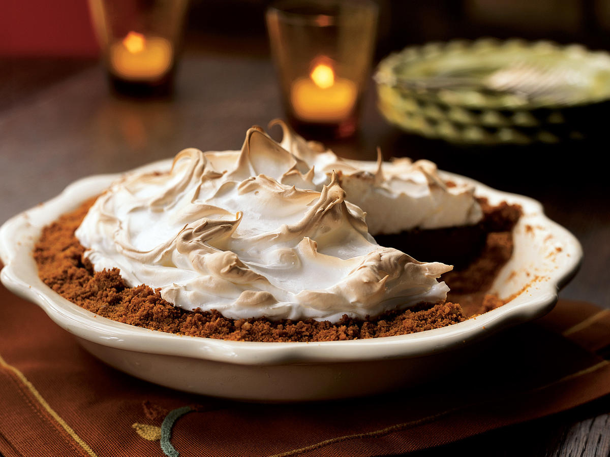 This is a pie that's dressed up for the prom. Inside, it's an old-fashioned, dense, sweet chocolate pie, but it's encased in a refined walnut crust and topped with elegant toasted meringue.