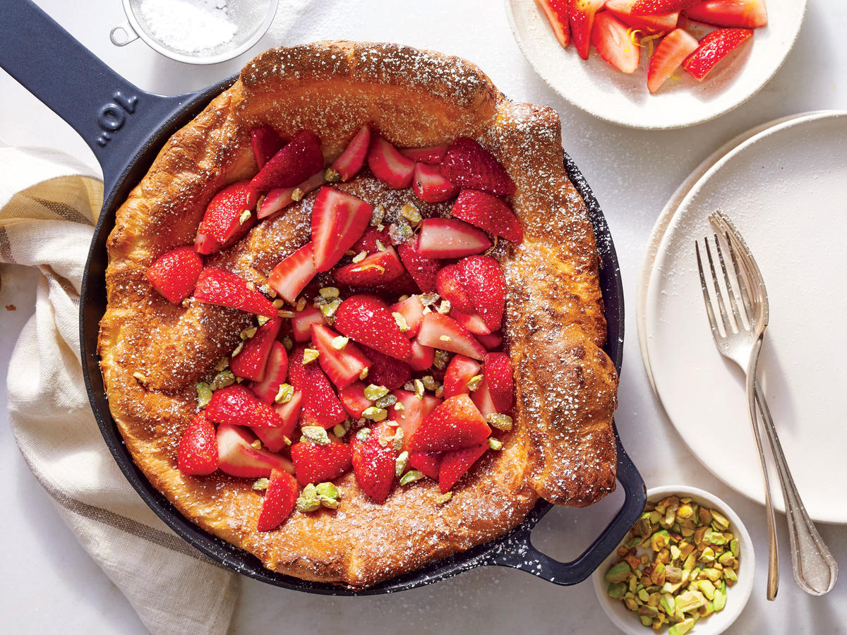 The key to the dish's dramatic puff comes from oven spring—the jolt of steam and heat the batter gets when it's poured into the sizzling-hot pan and then goes straight into a cranked-up oven. Make the strawberry mixture first so the fruit has time to macerate and get even juicier.