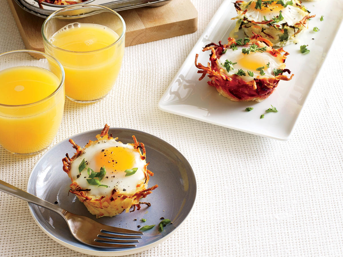 Our individual baked eggs nestled in crispy hash brown cups are pickup food at its best. It's a great way to serve a crowd; just cook up what you need in muffin pans. Good news: We got the best results with refrigerated shredded hash browns, which were far preferable to shredded fresh potatoes and save time and effort.
