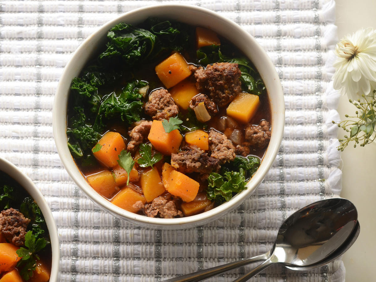 Tender lamb combines with fresh veggies like kale and butternut squash to create the ultimate comforting winter stew. Richly spiced with coriander, cumin, and paprika, the secret ingredient is also a dash of cinnamon. The best part of this simple paleo recipe is that the majority of the cooking time is hands-off, leaving you time to focus on other things.