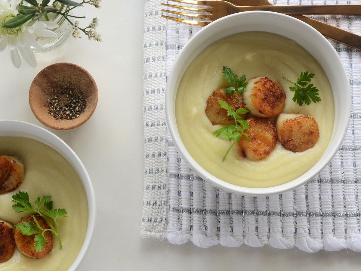 Pair sea scallops with a cauliflower and potato purée for an elegant yet weeknight-friendly meal. Tip: Patting the sea scallops dry before cooking helps ensure a great seared crust.