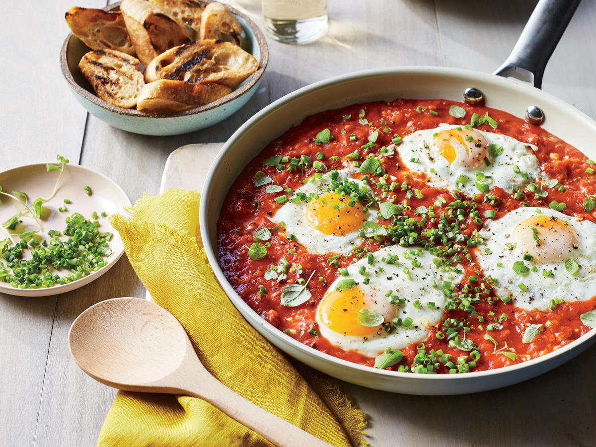If you've ever had Italian eggs in purgatory, this recipes makes a similar Israeli breakfast dish called shakshuka. If you need to stretch the meal, simply add another egg to the pan. Top with any herb, such as cilantro, chives, or oregano.