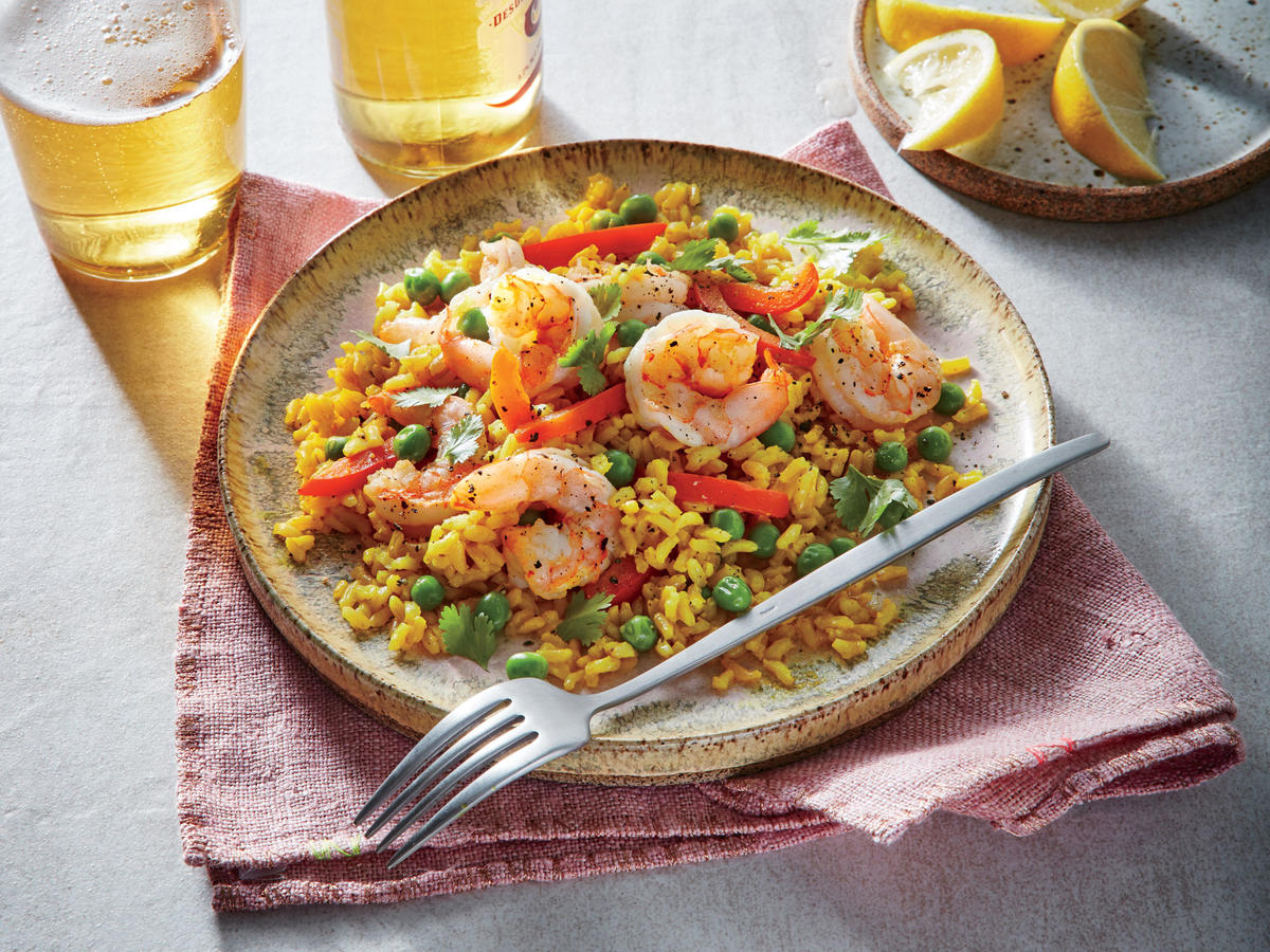 Fresh shrimp stars in this fast take on paella; you could also use chicken thighs. We swap expensive saffron for turmeric to achieve the yellow color.