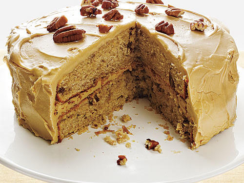 Work quickly to spread the warm maple frosting over the first layer, stack the second on top, and then spread the remaining frosting over the top and sides before it sets. If you prefer, you can substitute walnuts for the pecans in this luscious cake.