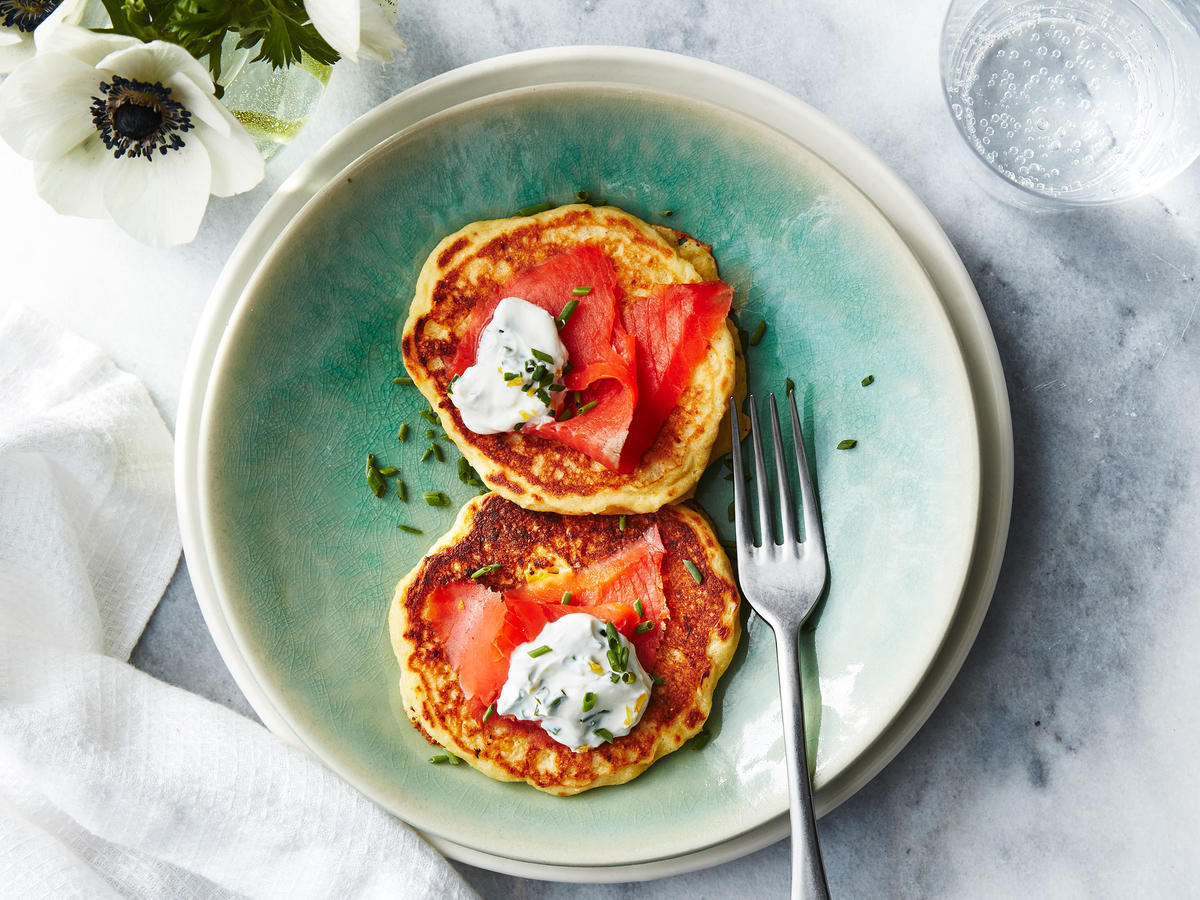 These savory pancakes are dressed perfectly with fresh lemon-chive cream and smoked salmon. Breakfast time, or anytime, these are a must try.