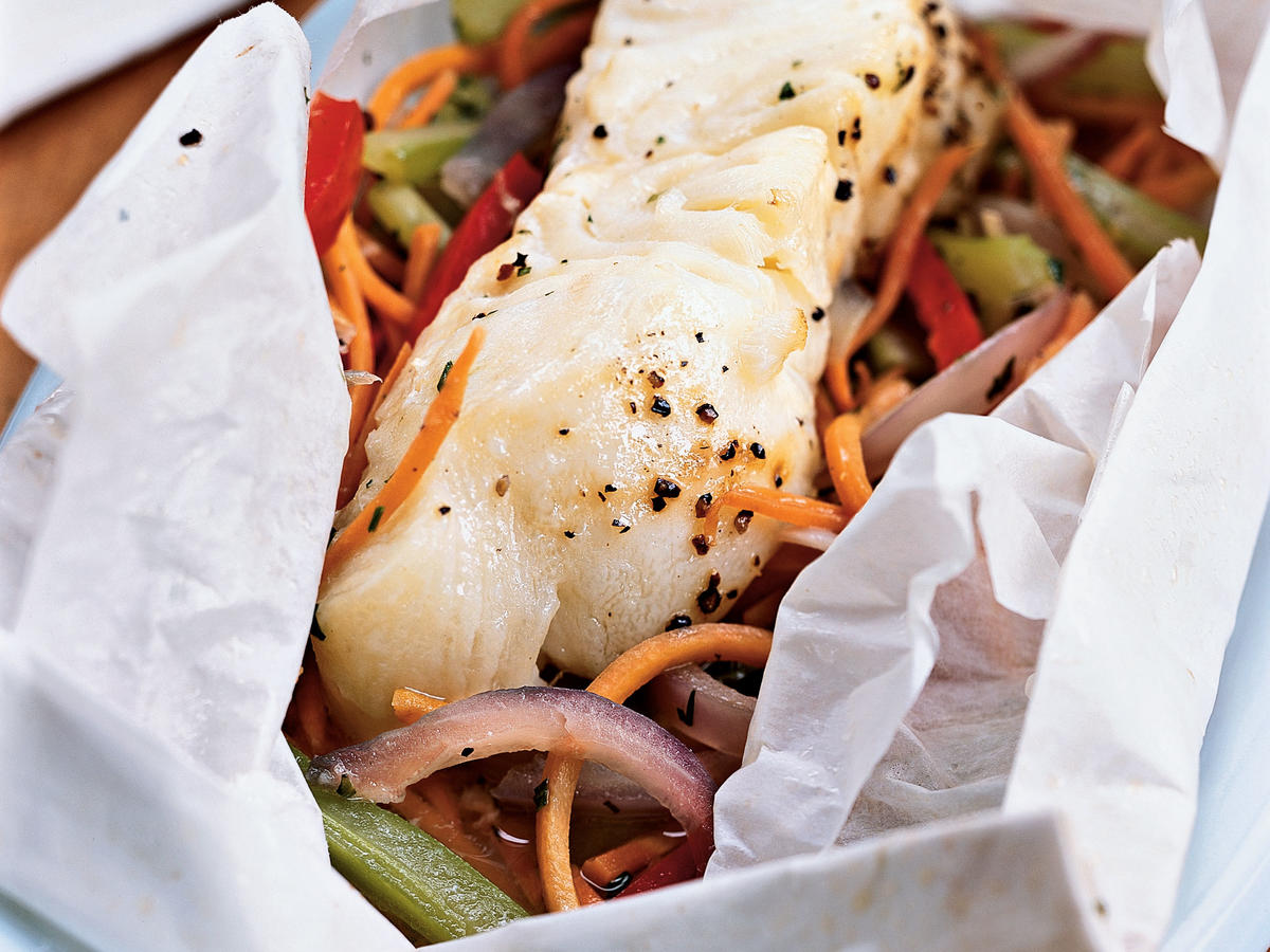 En papillote is the French term for food baked in a parchment paper packet; it's a favorite way of preparing fish in New Orleans. This recipe easily doubles to serve four.