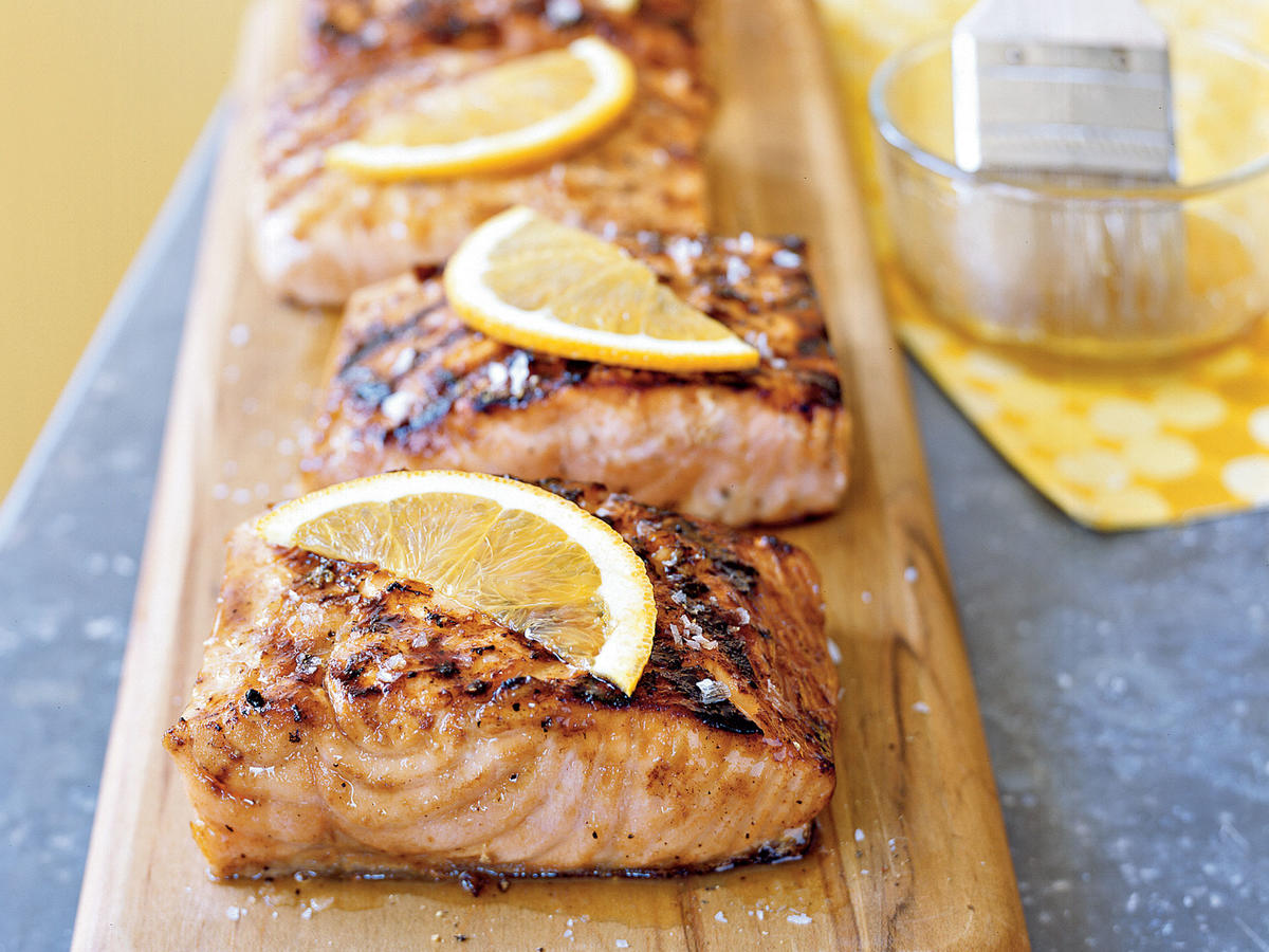 The sweet-sour marinade is cooked down to a syrupy glaze that's brushed on the salmon as it cooks. The citrus and maple flavors would also be tasty with pork. Garnish fillets with orange slices, if desired.