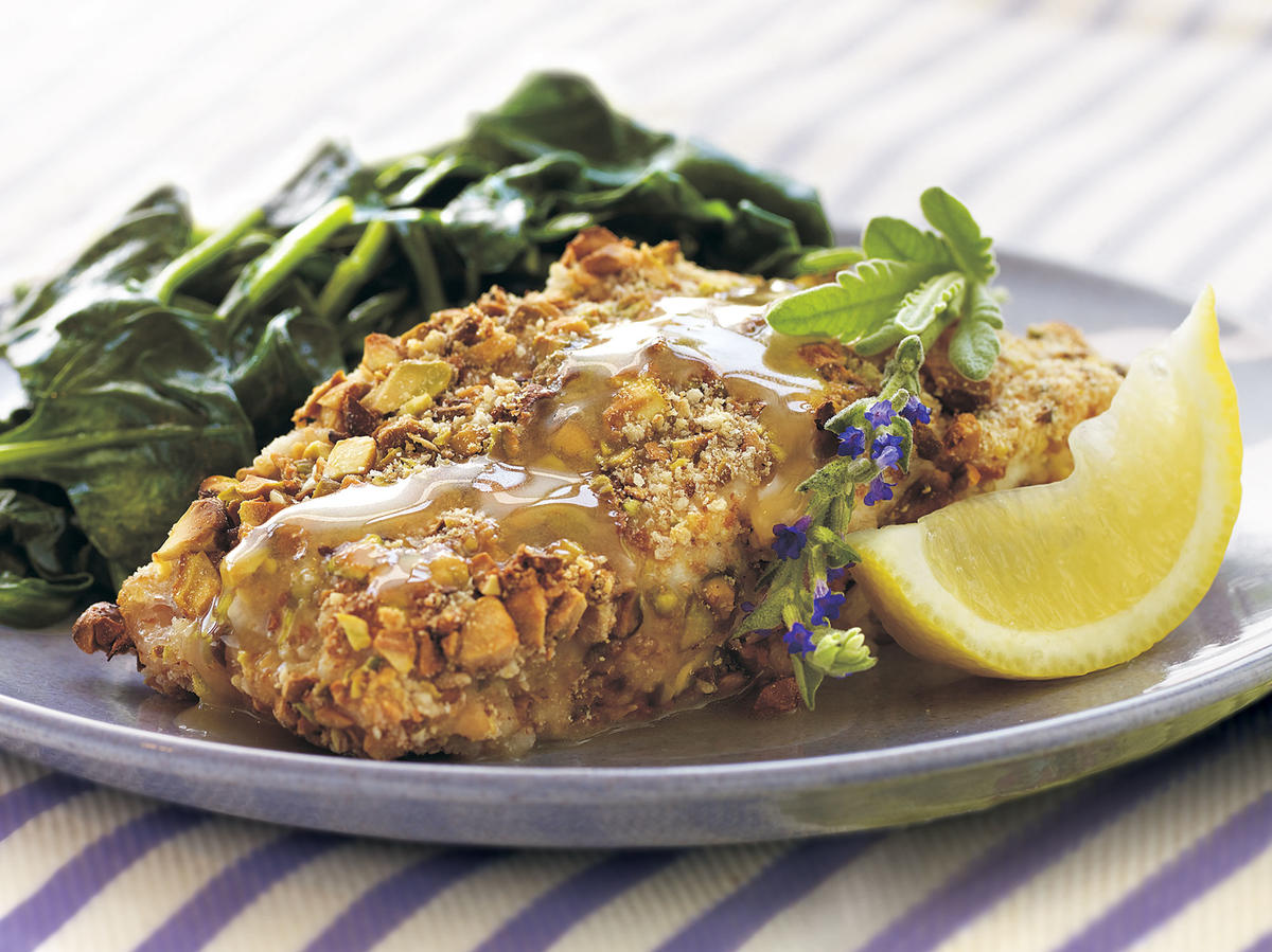 The delicate, subtle flavors of roasted pistachios and lavender honey transform this baked grouper into an easy, yet refined meal that family and friends will remember. Serve with sautéed spinach.