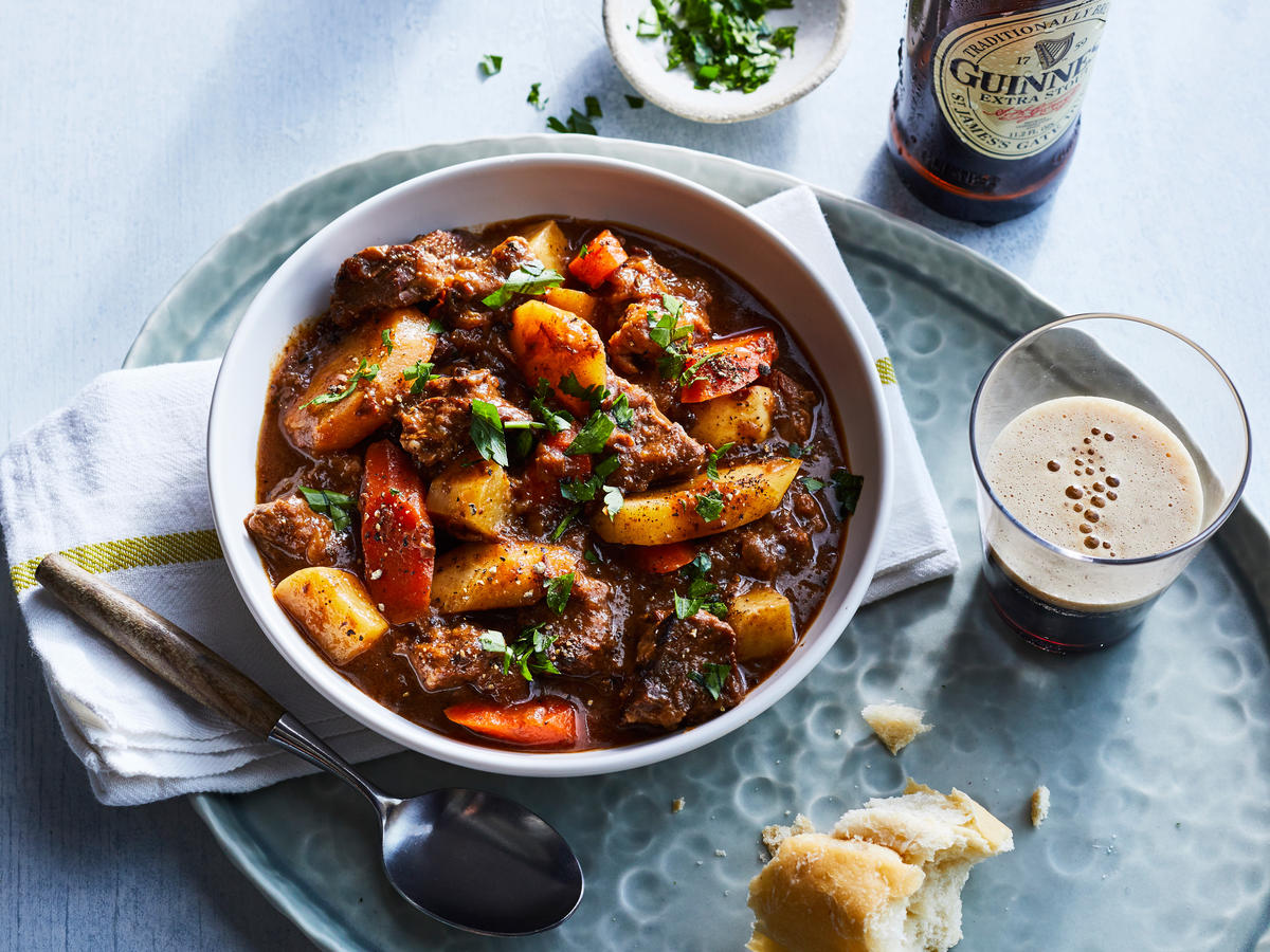 "This hearty stew, layered with complex flavors from caraway seeds, sweet raisins, and full-bodied Guinness Draught pays homage to the best of Irish cooking. Food Editor, Ann Taylor Pittman, promises ""This meaty stew is so good, I sopped up every drop of the gravy-like broth with bread."""