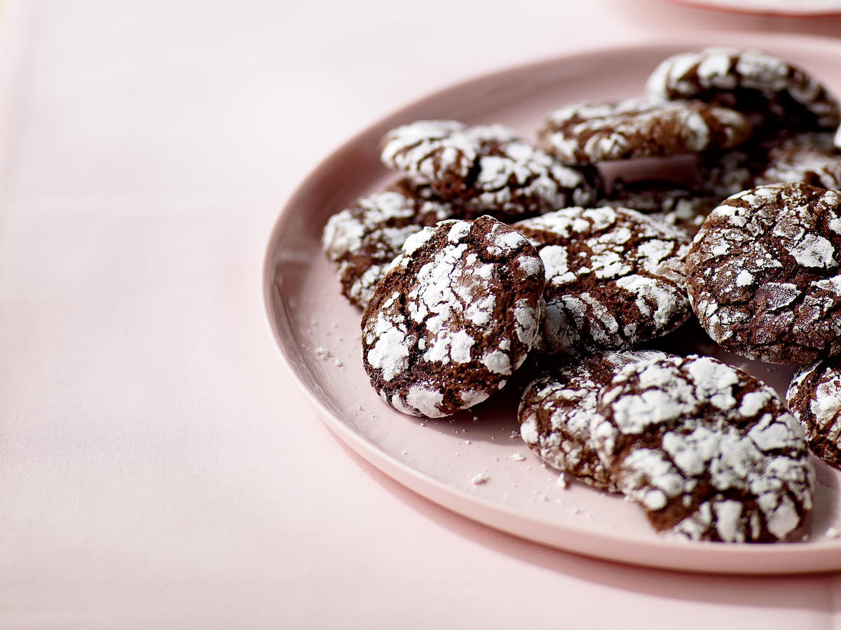 Unsweetened chocolate and instant espresso powder give depth of flavor to these sophisticated cookies. A dredge in powdered sugar before baking ensures sweetness, and also gives them a unique cracked surface and snow-covered look.