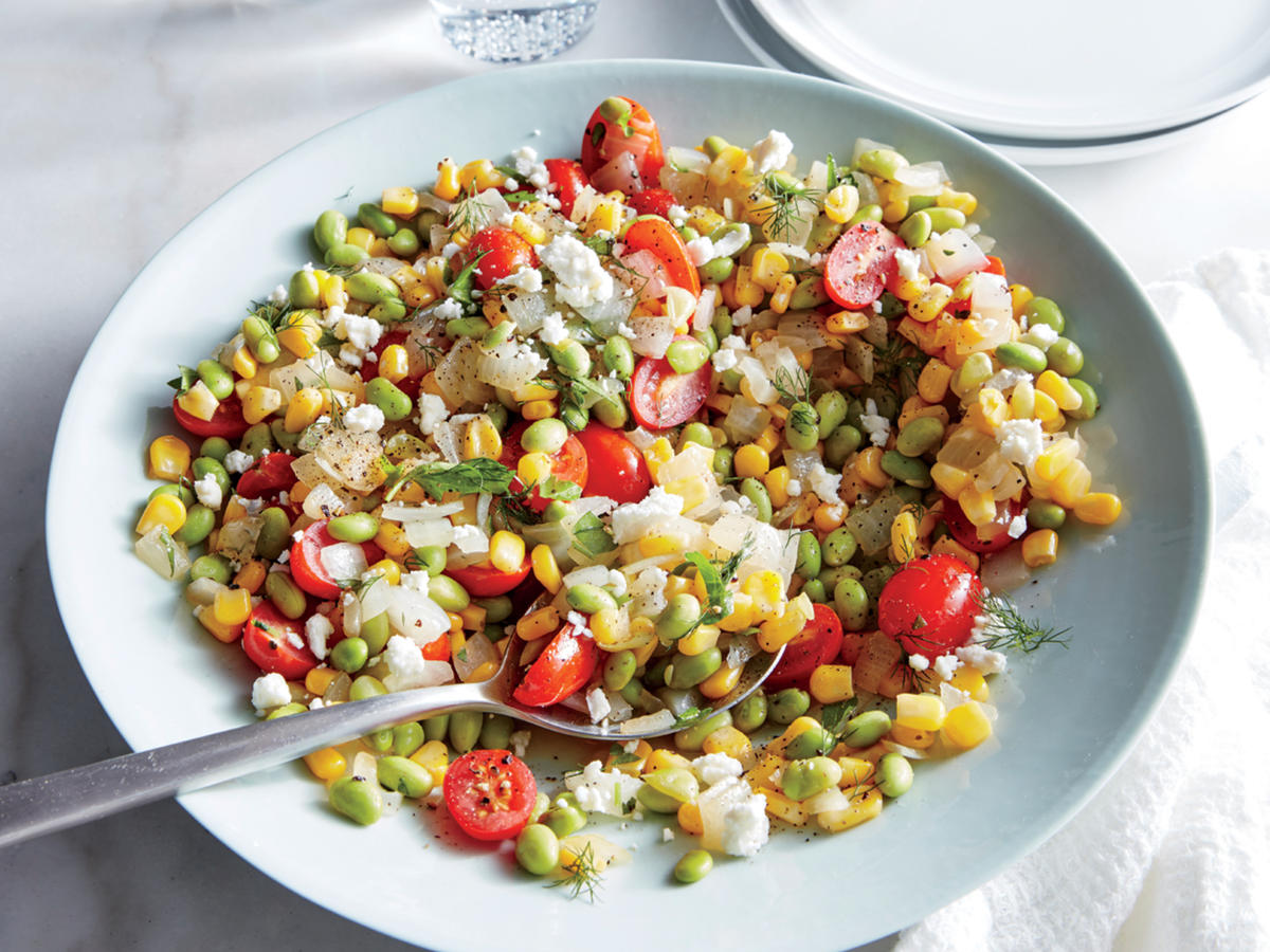Fresh, flavorful, and ready in 20 minutes, this vegetarian main is a family favorite. This speedy, veggie-packed entrée is light yet satisfying, and it holds up great when prepared a day in advance. We love for the glories of summer produce, but if they're not in season, frozen vegetables and year-round grape tomatoes do the job wonderfully. Edamame adds hearty texture and a hit of plant-based protein.