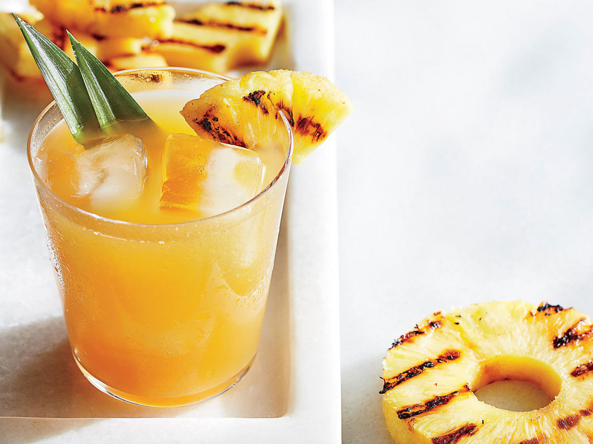 This twist on classic lemonade is the divine union of fruity and smoky flavors. Naturally sweet pineapple goes into the drink, allowing us to use less added sugar. We use an indoor grill pan, but if your outdoor grill is already fired up, use it to lend extra smoky depth. Add a boozy spin with a dash of rum or tequila.