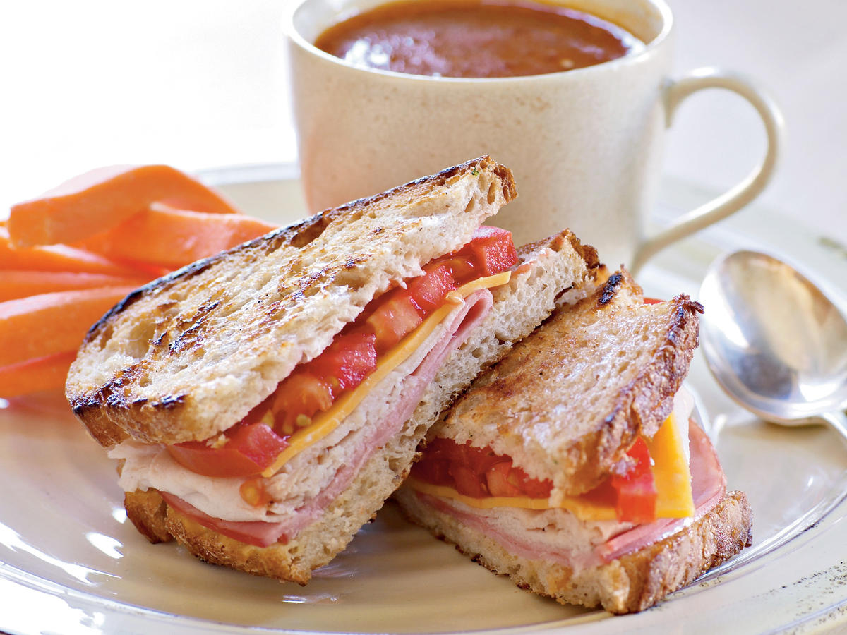 Simplicity is the key to these easy sandwiches: Bread, mayo and mustard, deli meats, cheese, and tomato are all you need for a quick meal anytime. But toasting them in a skillet turns them into a gooey, melty, comforting classic. And of course, they need to be paired with