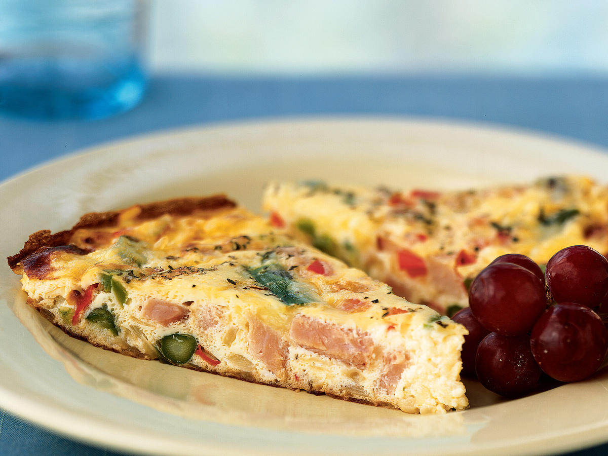 Leftover Thanksgiving, Christmas, or Easter ham is a perfect candidate for this recipe―a thick, hearty open-face omelet suitable for breakfast, brunch, lunch, or dinner. Turn the frittata into a quiche by pouring the mixture into a pie crust before baking.