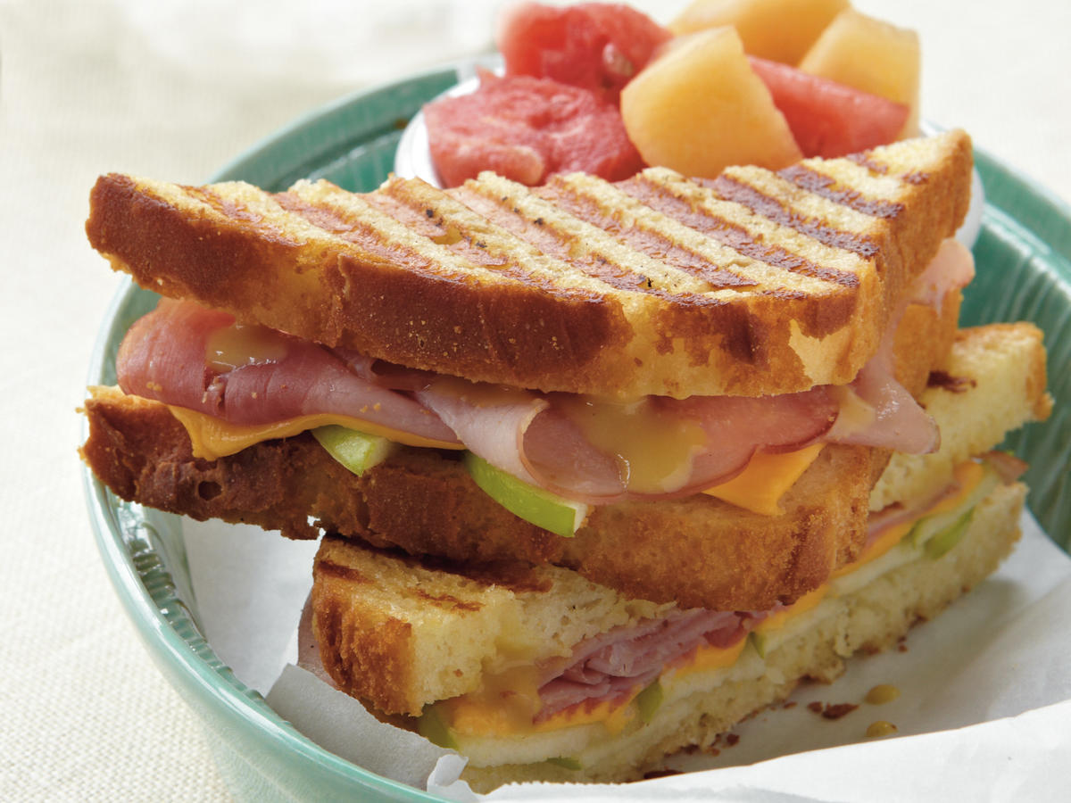 If you don't have a panini press, you can make these easy sandwiches in a nonstick skillet, much like you make grilled cheese sandwiches.
