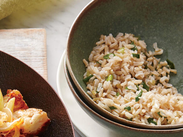 Perk up precooked brown rice with fresh orange rind, a faintly floral note that's welcome in stir-fries and other classic Asian dishes. If you like, you can add chopped toasted almonds or peanuts for extra crunch.