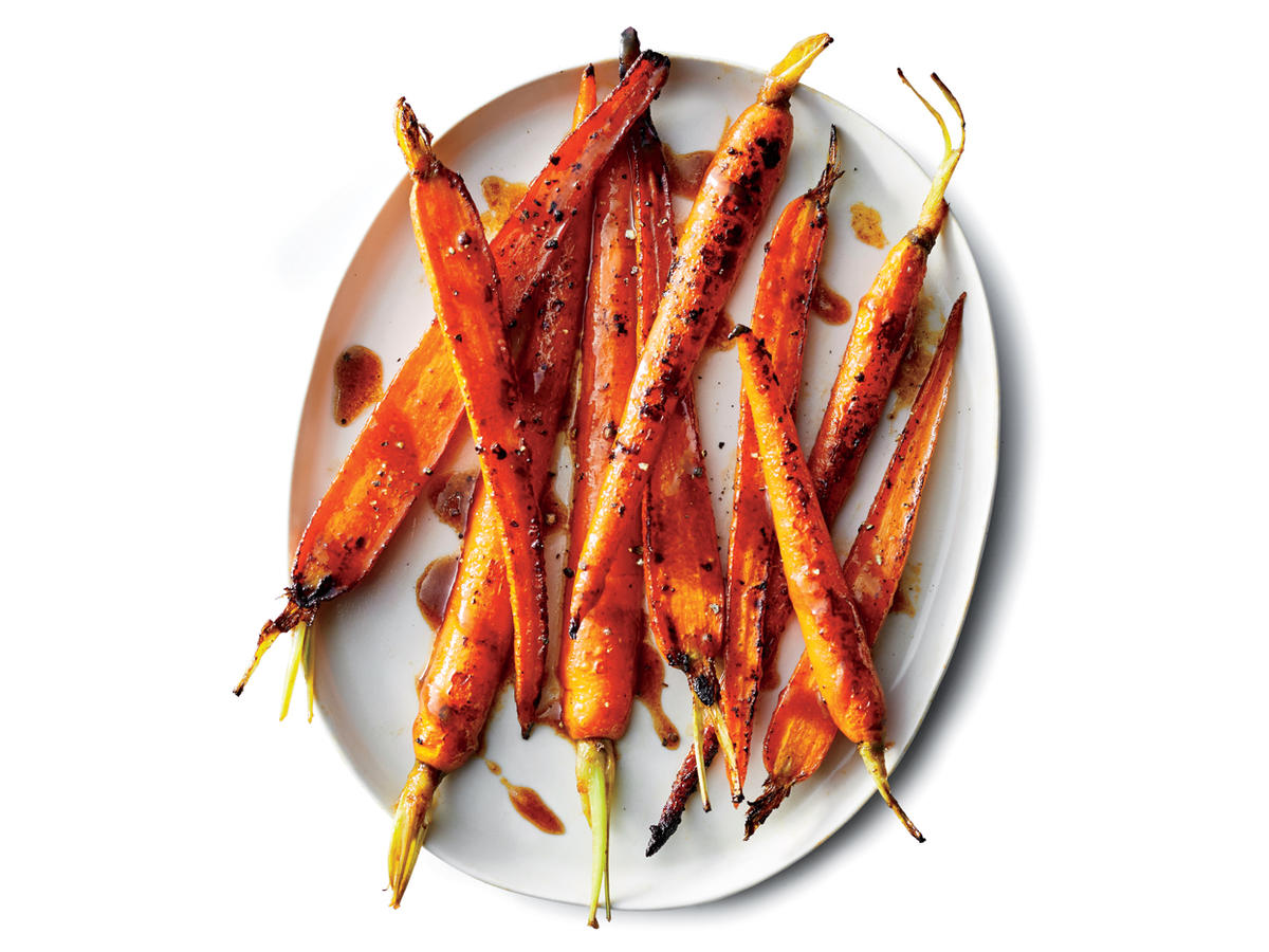 "This recipe gives you a faster route to ""roasted,"" lightly caramelized carrots. Instead of cooking in the oven (and waiting for it to preheat), here you cook the carrots on the stovetop in a cast-iron skillet. The key is to keep the carrots still; you'll cook them for 5 minutes without stirring, then stir and cook undisturbed for another 5 minutes. The results are beautifully browned, crisp-tender carrots that take about a third of the time as oven-roasted. A hint of hoisin and maple syrup enhance the sweetness of the carrots without rendering them cloying."