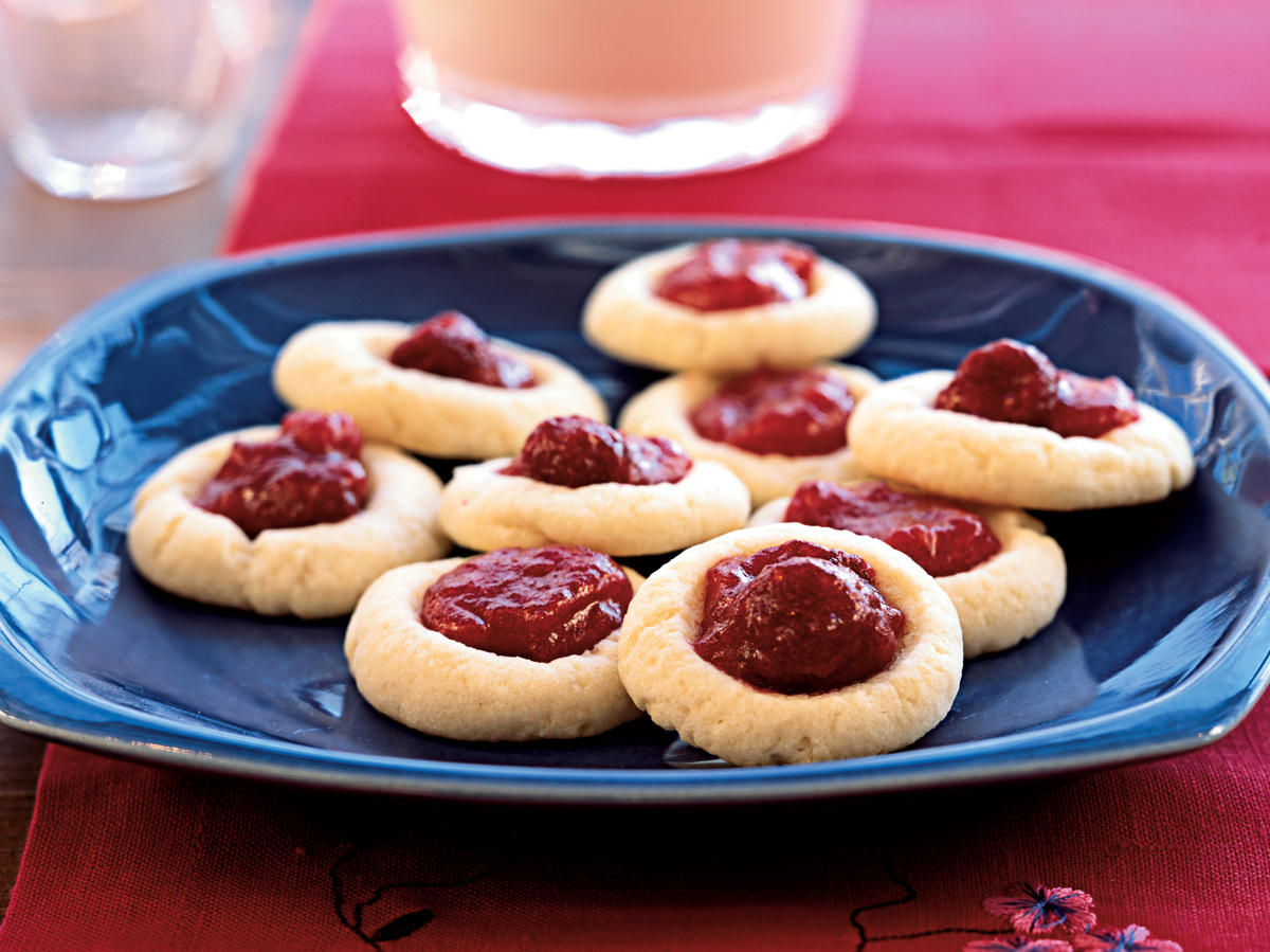 Add some color to your bake sale cookie tray with these jam-filled thumbprints. This recipe could also be your healthy alternative for the next school party.
