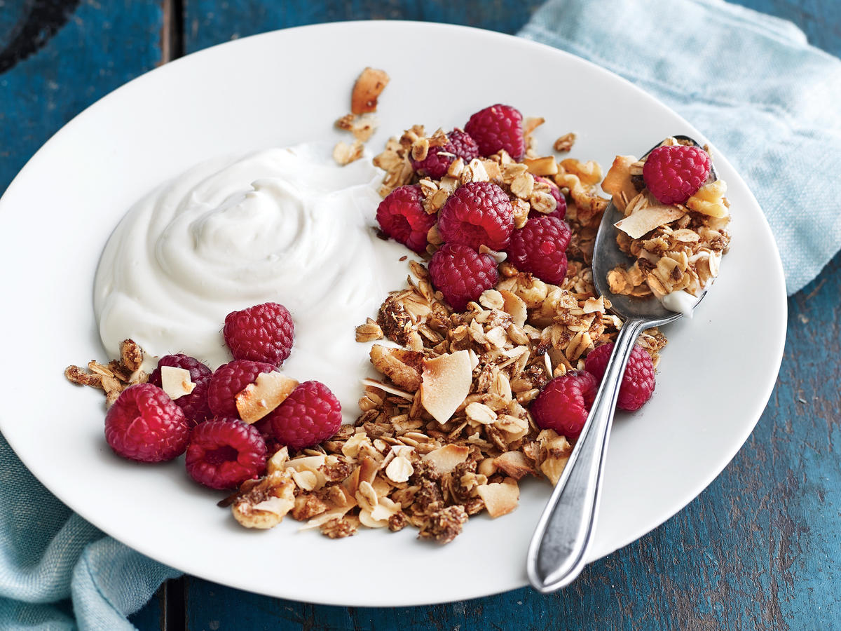 To make this portable breakfast a snap, prepare the granola in advance and store it in an airtight container. Be sure to keep a close eye on the broiler so the granola doesn't burn. You can also sub pitted fresh cherries or any ripe berry for the raspberries.