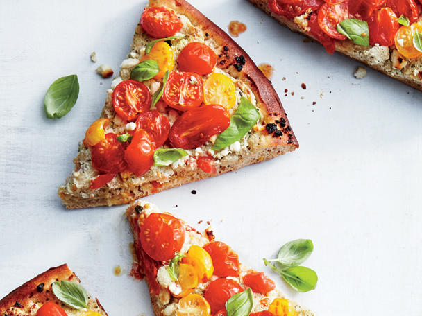 Red tomatoes are richer in antioxidants when cooked, giving you better access to lycopene (a disease-fighting antioxidant). The higher-quality ricotta you use, the creamier, and more delicious the pizza; we prefer Calabro brand.