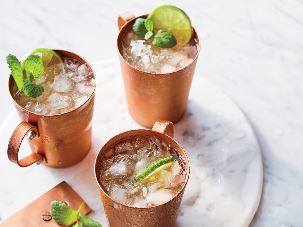 A classic Moscow mule—spicy ginger beer, tart lime, and vodka served in a chilled copper mug—is as frosty and refreshing as a snow cone. This fresh twist uses barrel-aged bourbon and a hint of mint for a mule with Kentucky-style giddyap. Copper mugs are in: Find ones similar to these at Crate & Barrel ($20).