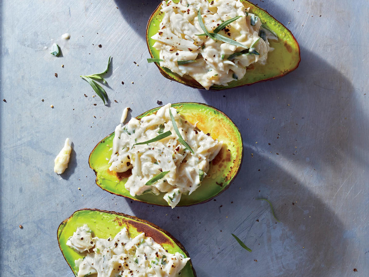 We couldn't resist stuffing cup-shaped avocado halves, here gently seared until lightly caramelized. Sweet crabmeat dressed with zingy lemon and tarragon is a nice complement to the buttery avocado; chopped cooked shrimp or shredded chicken breast would also work. You could also fill the halves with a fresh summer squash salad or black bean salsa.