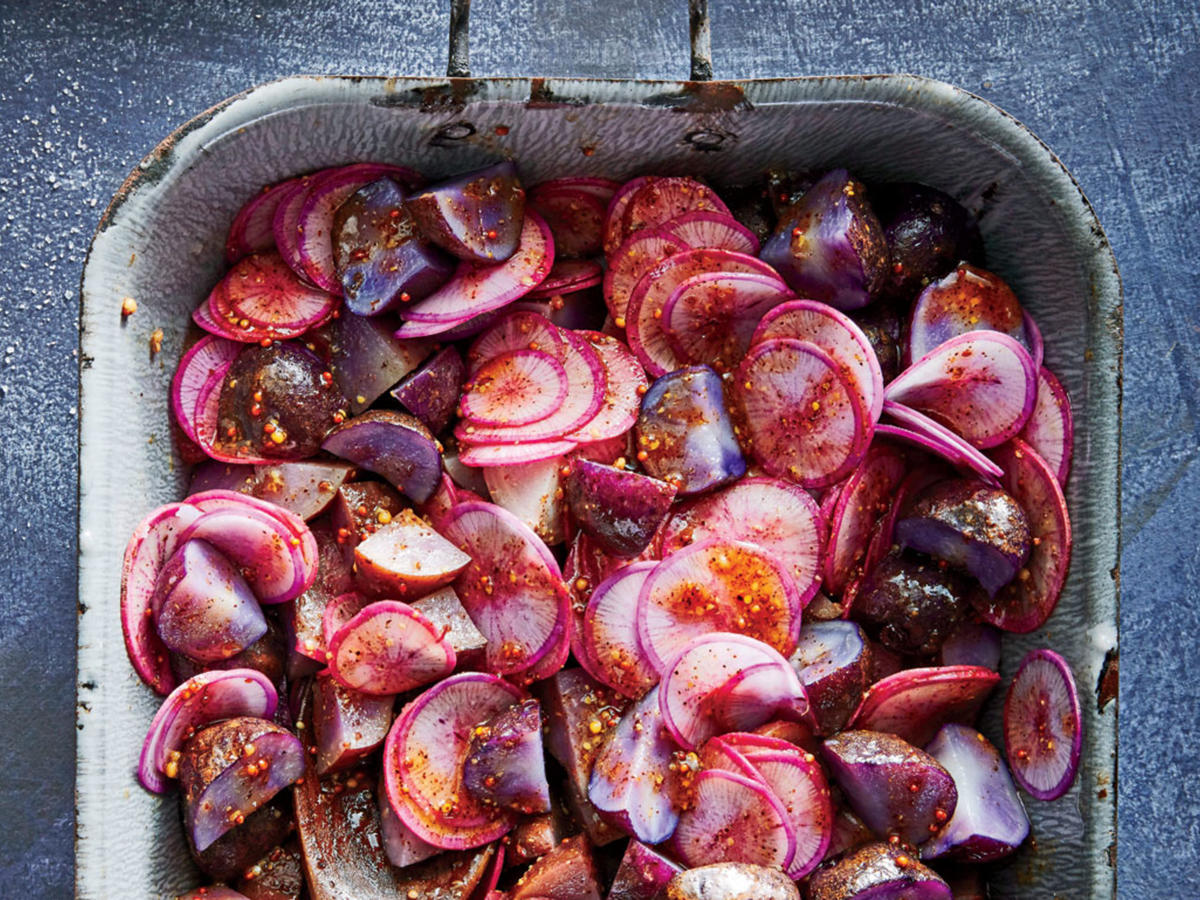 This is the recipe you need for those potluck gatherings where you really want to impress but then find you're supposed to bring … potato salad. This version will wow, from its beautiful indigo color to its rich, smoky flavor. A nice hit of cumin and chipotle chile powder amplifies the smokiness and makes for a deeply savory salad. If the purple potatoes (or other small, waxy potatoes if you can't find purple ones) are larger than we specify, cut them in half so they'll cook evenly and get tender.