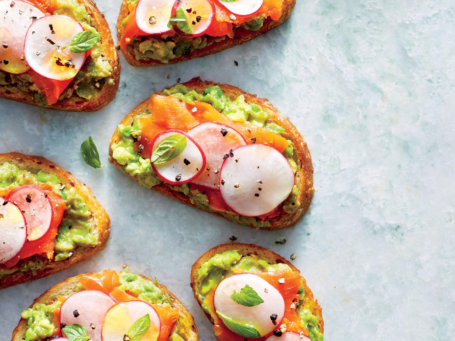 "Elevate your avocado toast with silky smoked salmon for a lunch worth bragging about. This recipe delivers a double dose of heart-healthy unsaturated fats from both salmon and avocado, plus 35% of your daily fiber goal. Be sure to look for salmon that's labeled ""wild Alaskan."" That way you can be sure you're getting sustainable seafood."