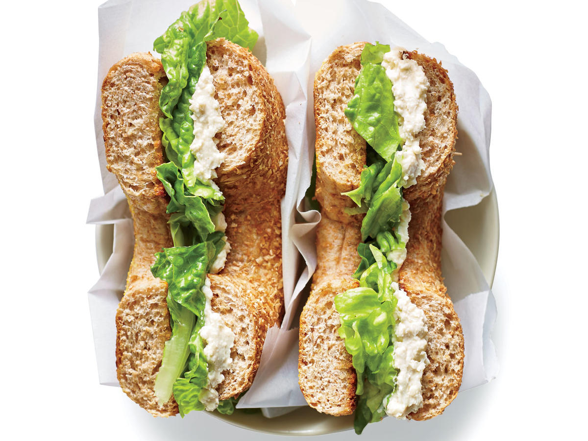 "Enjoy this crunchy, creamy bagel sandwich for breakfast, lunch, or dinner. The cream cheese ""schmear"" itself should become a fridge staple; it tastes just like Caesar salad dressing but is thick and spreadable. Try it on toast, on a burger, or stirred into scrambled eggs for a savory boost. We prefer whole-wheat bagels, but you can also opt for onion bagels or everything bagels for more allium flavor. Do be sure to grab romaine lettuce; you want a sturdy, crunchy lettuce for this sandwich."
